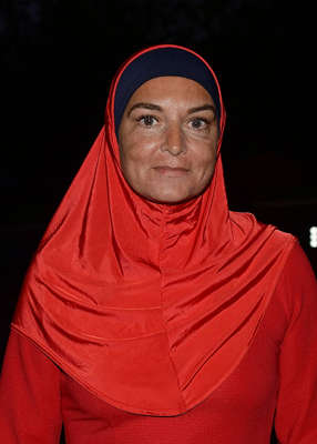 Sinéad O'Connor wearing a hat: Sinéad O'Connor, the next day in the same restaurant, interviewed Ian Bailey for an article she was due to produce. Pic: VIP Ireland