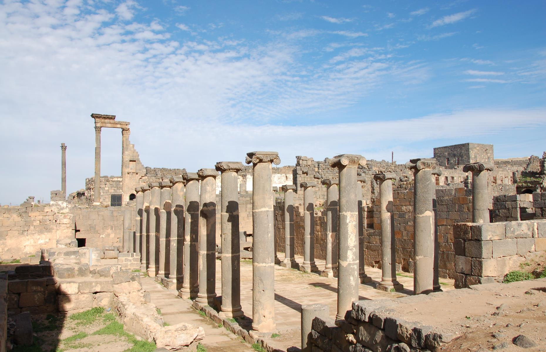 Slide 41 of 53: This ancient city was once the capital of the Roman province of Arabia and a stopover for pilgrims on the ancient caravan route to Mecca. The site included a magnificent 2nd-century Roman theater, early Christian ruins and several mosques. As a result of the ongoing civil war, fighting has caused irreparable damage to much of this precious historical site.