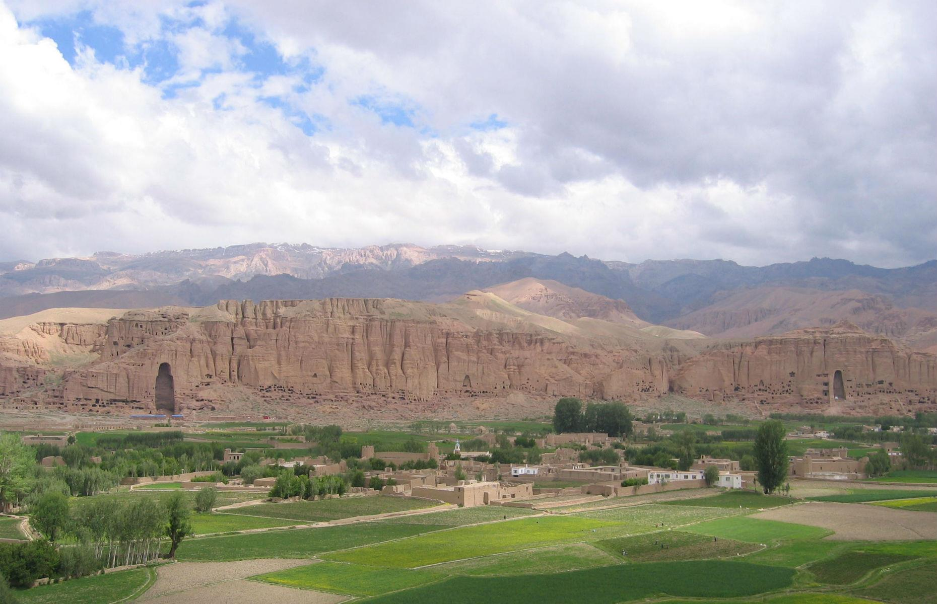 Slide 2 of 53: The archaeological remains of the Bamiyan Valley, containing fortified buildings from the Islamic period as well as Buddhist monastic ensembles and sanctuaries, are one of Afghanistan's most significant sites. However, the area has been shaken by political unrest and terrorism; in 2001 the two standing Buddha statues – formerly the largest standing Buddha carvings in the world – were destroyed by the Taliban. In 2007, two more attacks severely damaged an ancient rock carving of a seated Buddha.