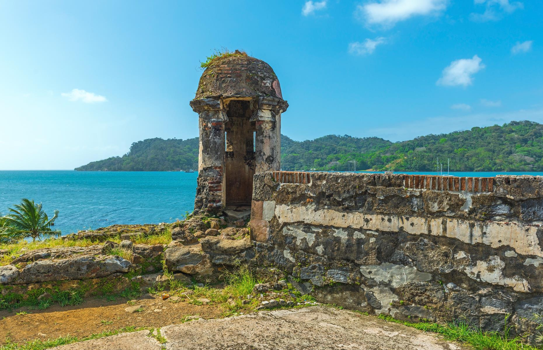 "Slide 35 of 53: The 17th and 18th-century military fortifications on Panama's Caribbean coast are described as: ""a masterpiece of human creative genius"" by UNESCO. They formed part of a defense system built by the Spanish crown to protect transatlantic trade. Portobelo was a major Caribbean port and played a leading role in controlling the imperial trade in the Americas. It's been deemed as at risk since 2012 due to a variety of environmental factors, as well as uncontrolled urban sprawl and development and a lack of maintenance and management."