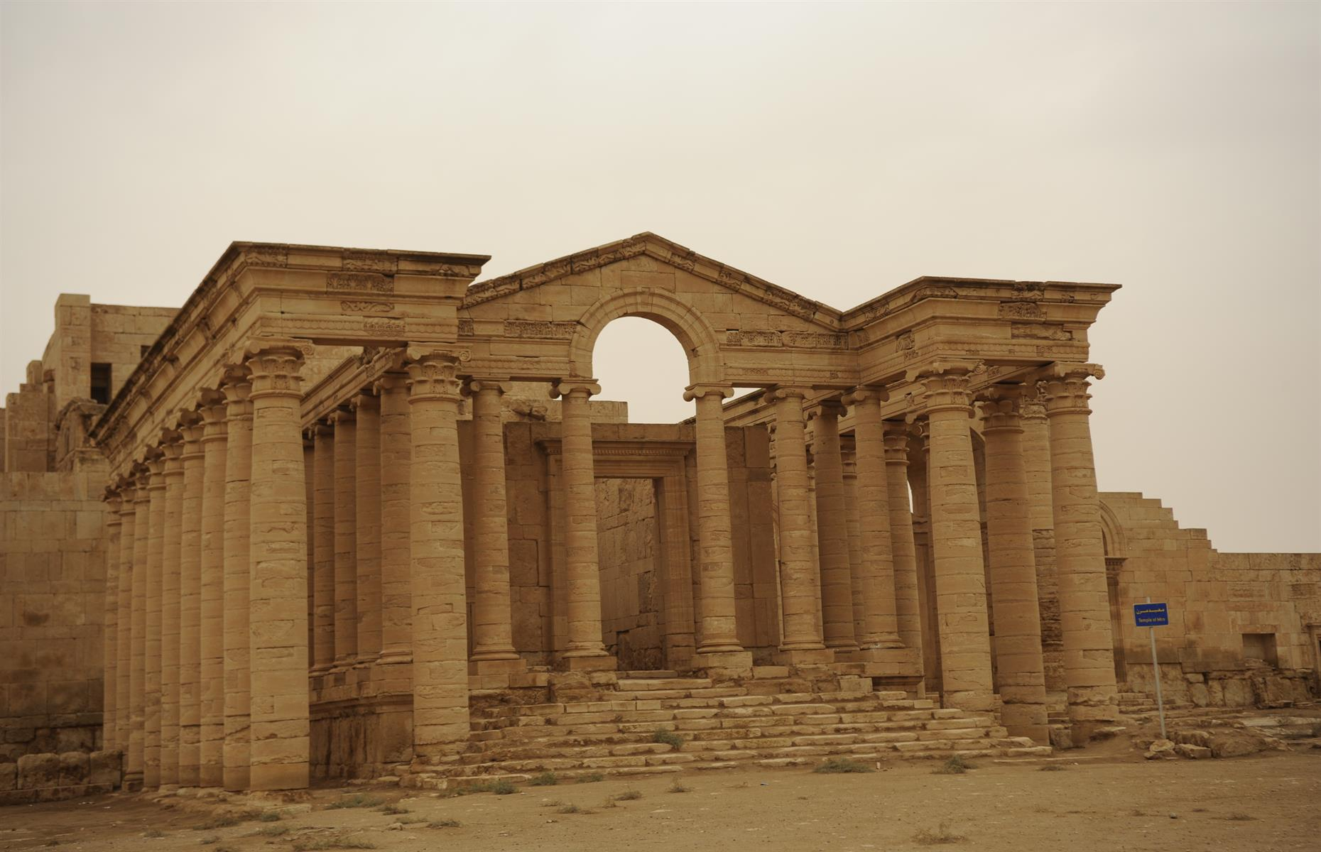 Slide 17 of 53: The fortress city of Hatra, which dates back to days of the Parthian empire in the 3rd or 2nd century BC, was the capital of the first Arab Kingdom. Known for its mighty walls and towers, which helped it withstand two Roman invasions in the 2nd century AD, its architecture represents a unique blend of Hellenistic and Roman styles with eastern decorative features. It was taken by Isis in 2015, who used sledgehammers and guns to destroy carvings and statues. It is undergoing a lengthy restoration process.