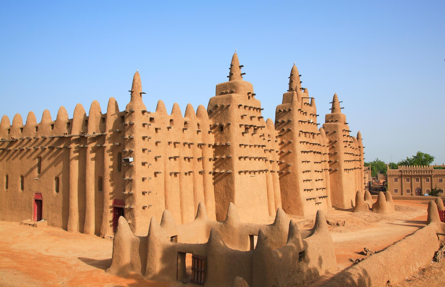 Slide 27 of 53: One of the oldest towns of sub-Saharan Africa, the Old Town of Djenné has been inhabited since 250 BC. It became an important link in the trans-Saharan gold trade and was one of the centers for the propagation of Islam in the 15th and 16th centuries. Nearly 2,000 of its original mud-walled houses have survived. Its mosque and other historic buildings were designated a World Heritage Site in 1988 for being representative of Islamic architecture in sub-Saharan Africa. It was inscribed on the danger list in 2016 due to insecurity affecting the area.