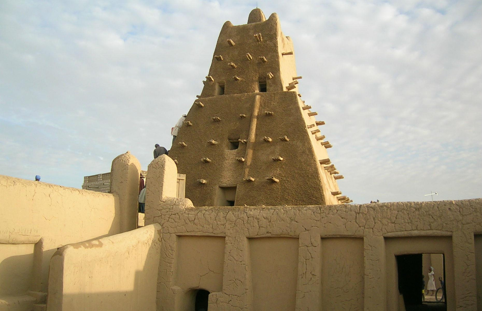 "Slide 29 of 53: Timbuktu is one of Africa's most historically significant cities: home to the Koranic Sankore University and other madrasas, Timbuktu was an intellectual and spiritual capital, and was also central to the promotion of Islam in Africa in the 15th and 16th centuries. Its three great mosques are said to ""recall Timbuktu's golden age"". However, despite being continuously restored, these monuments are under threat: armed conflict in the region, illegal trafficking of cultural objects by looters and dealers, and suicide bombings are just some of the dangers that Timbuktu faces."