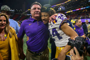 Ed Orgeron standing in front of a crowd: LSU cornerback Derek Stingley Jr. was hospitalized on Friday night.