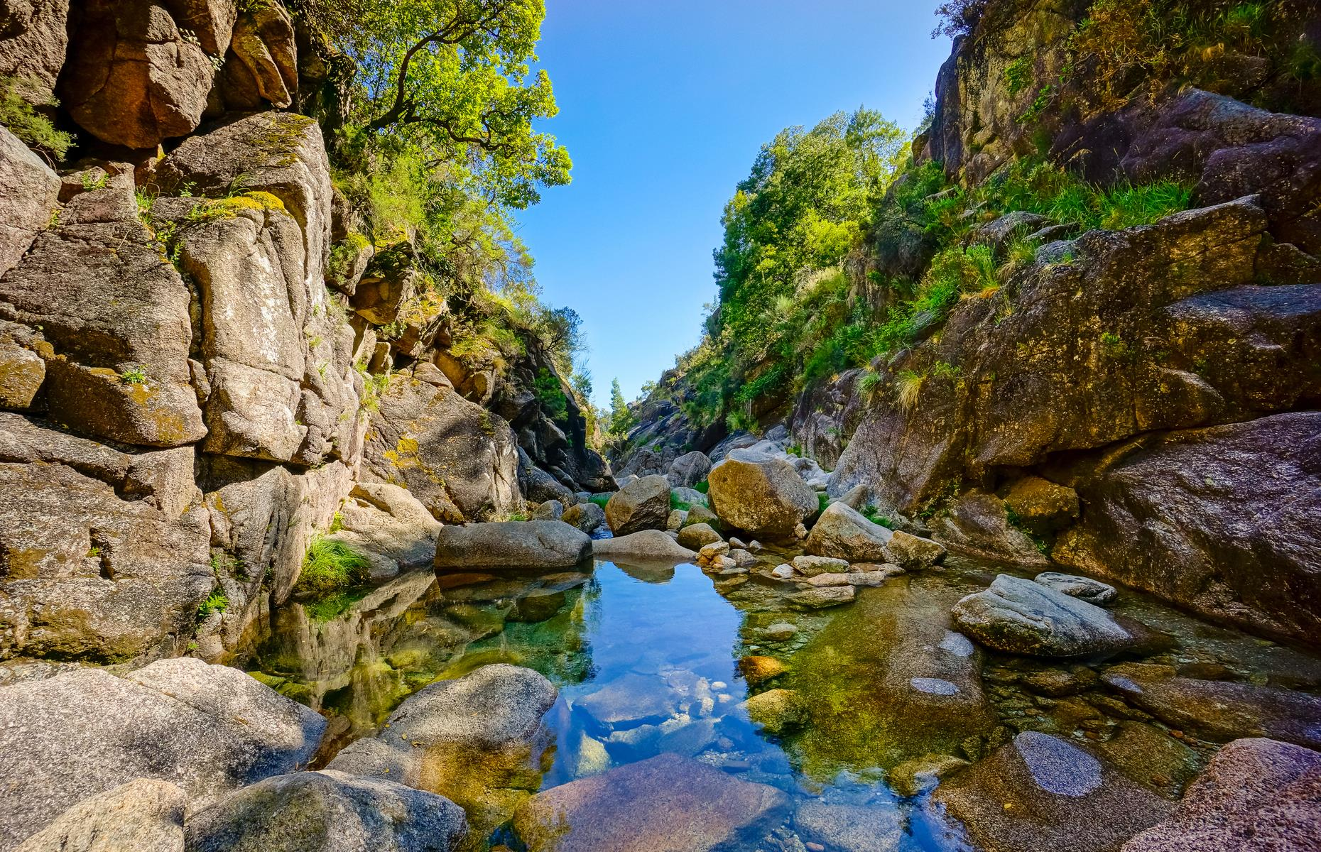 Slide 20 of 31: In northern Portugal near the Spanish border lies the 271-square-mile (702sq km) Peneda-Gerês National Park, full of vast, stony landscapes, oak forests and glimmering mountain creeks. Established in 1971, it's just over an hour's drive from the charming city of Porto. The rich array of wildlife includes wild ponies, wolves, otters, plus 15 species of bat (including 10 that are endangered).