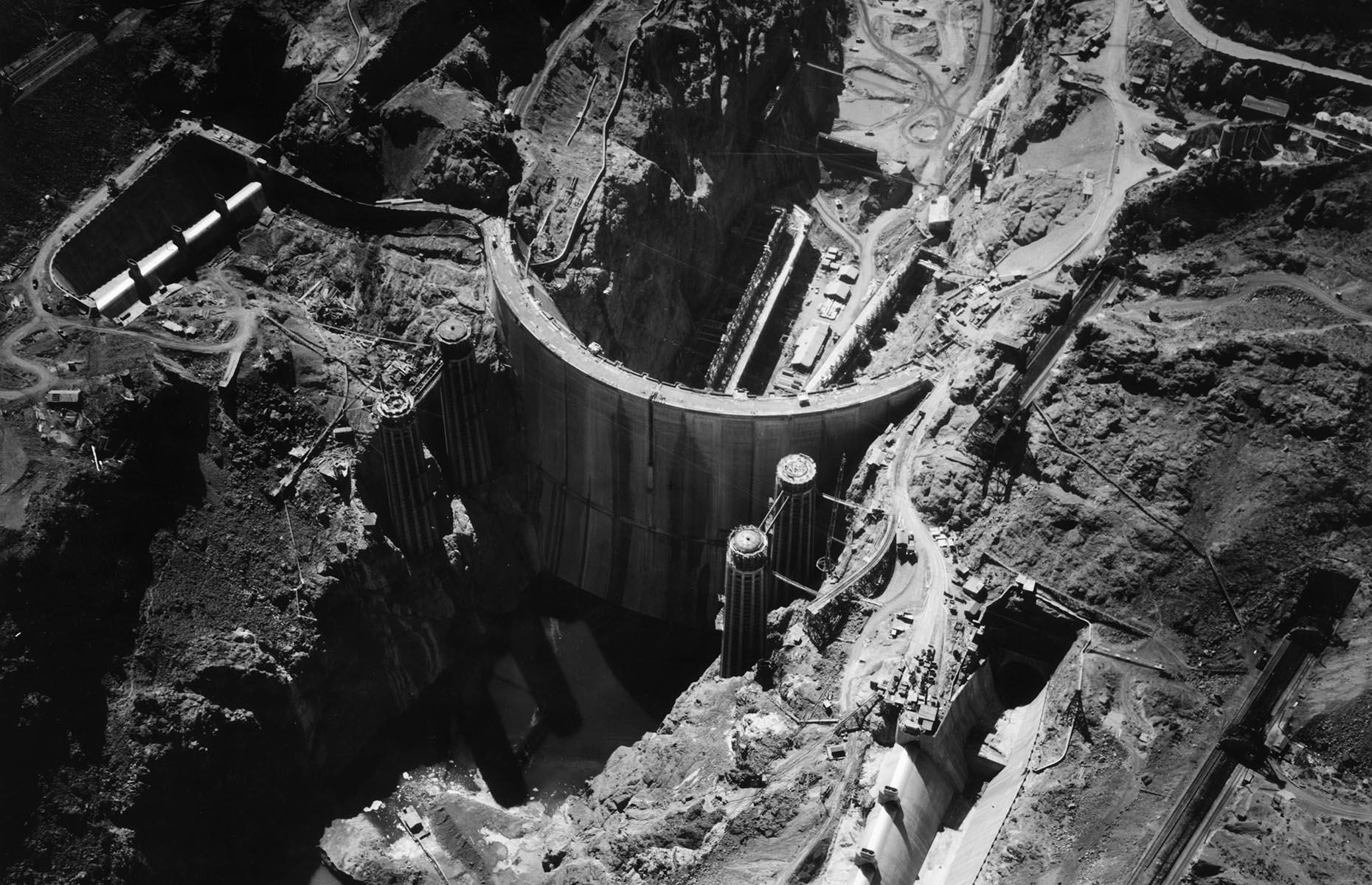 Slide 9 of 34: The construction of the Hoover Dam is still probably the most significant development in the city's history. Its construction brought in new residents (and gamblers) and it gave the valley's economy a much-needed boost during the Great Depression. It also provided two key commodities in ample supply – water and electricity. Finished in 1936, it's still one of the largest and most ambitious public works ever undertaken by the federal government.