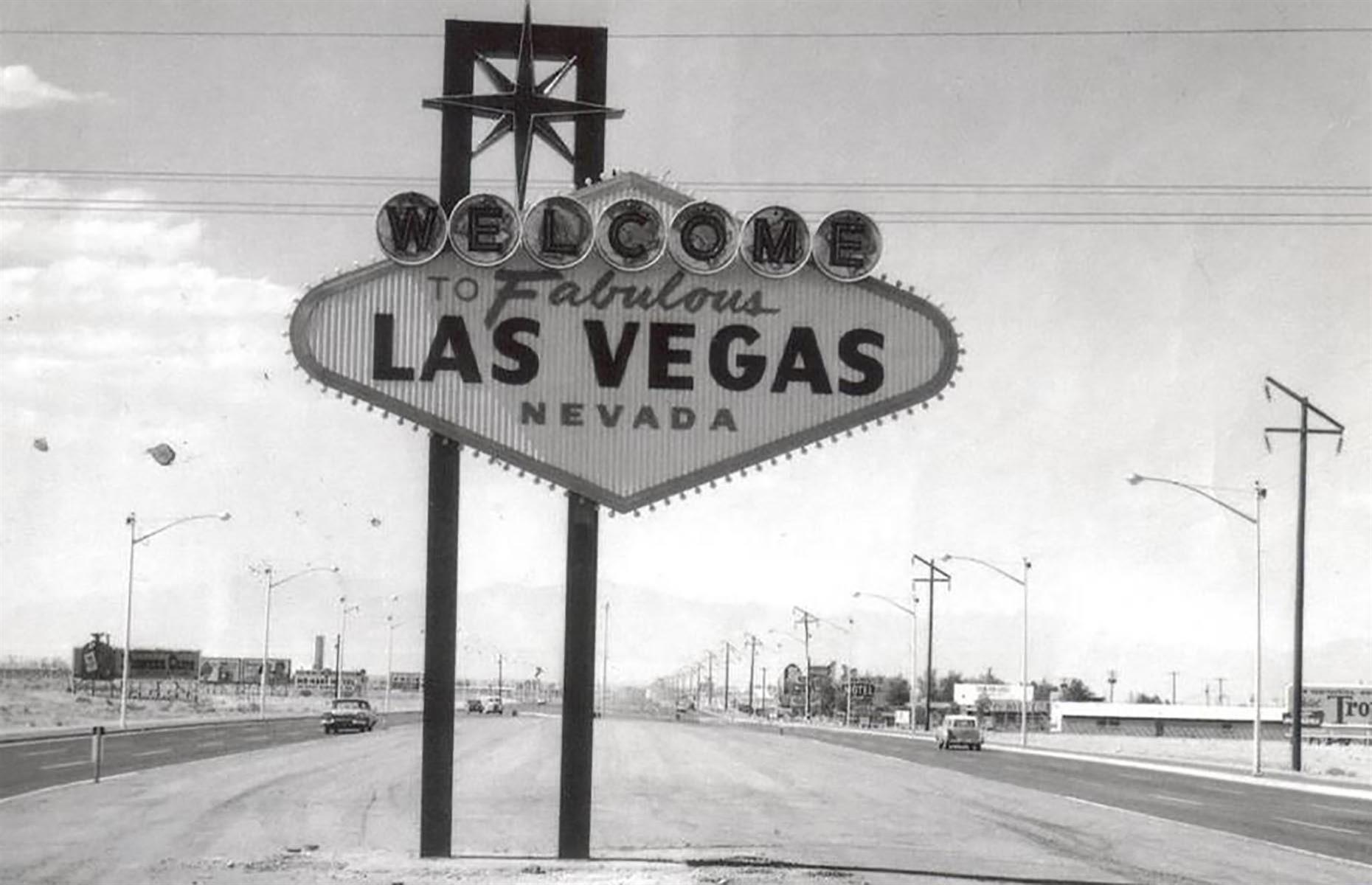 Slide 20 of 34: Today the Welcome to Fabulous Las Vegas sign is recognized all over the world. The original sign (there are three replicas) stands at what is considered the southern end of the Las Vegas Strip. The sign was built and installed in 1959 by Western Neon and it was designed by Betty Willis, an employee of the company. She considered it a gift to the city so there is no copyright on it. Funnily enough, it's never marked the actual city limits of Las Vegas. Even today it sits around four miles (6km) from the actual city of Las Vegas.
