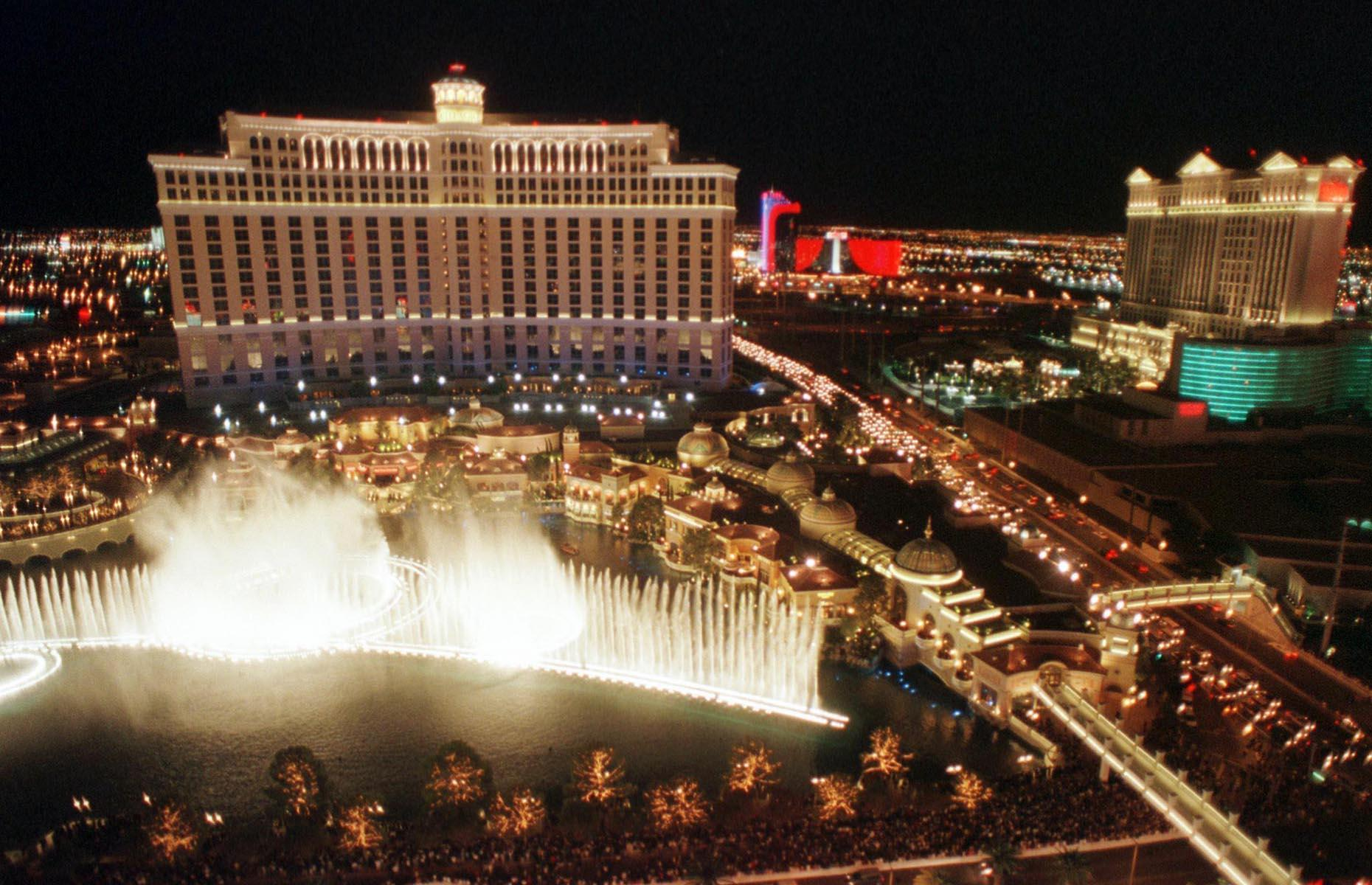 Slide 29 of 34: During Las Vegas' history there have been several hotels that have set the city on a new course and the Bellagio is one such hotel. Opened in 1998 (pictured here on opening night), the hotel and the Fountains of Bellagio, a choreographed water feature with performances set to light and music, were built on the site of the demolished Dunes. One of the most spectacular hotel-casinos to ever open on the Strip, it shifted the focus to luxury and helped create the image of modern Las Vegas with appearances in films like Ocean's Eleven and The Hangover.