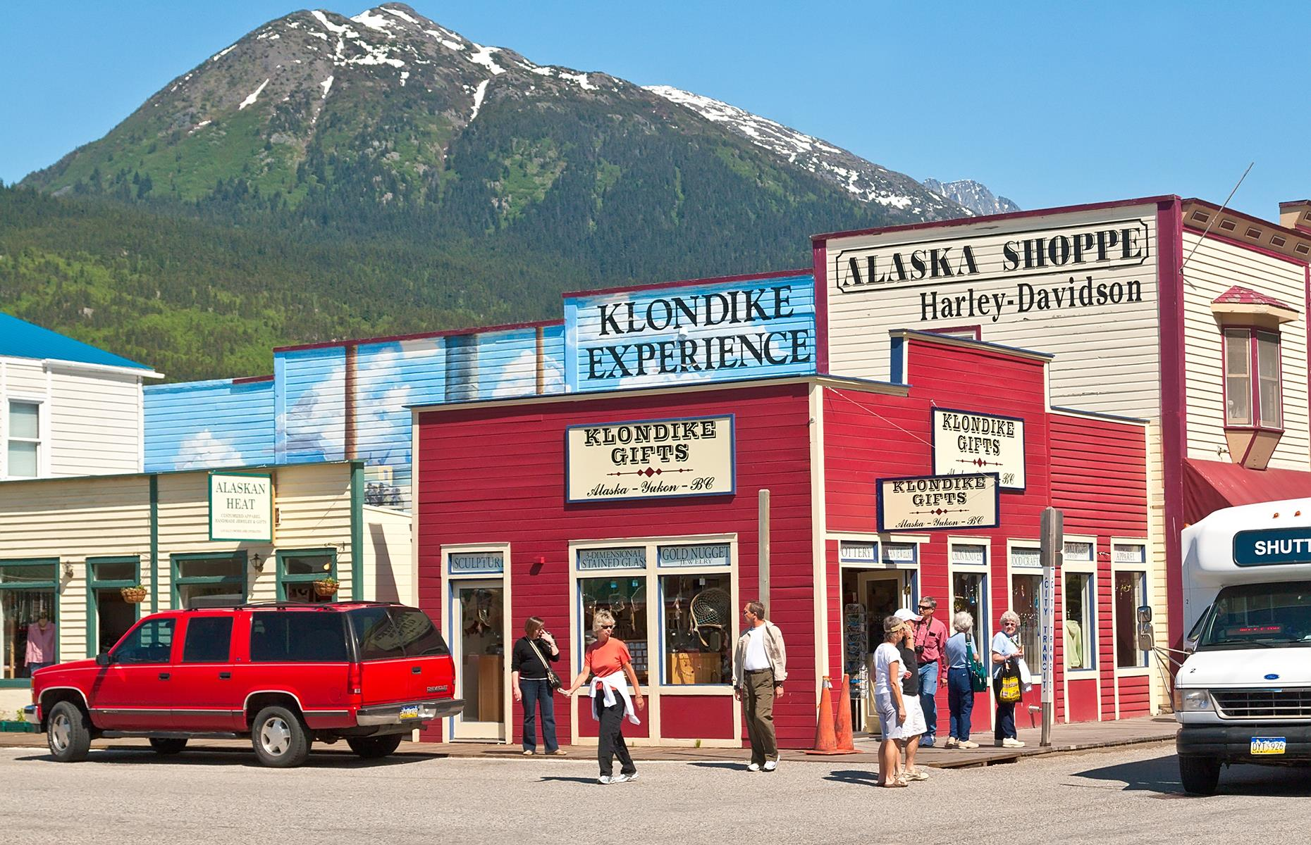 Slide 20 of 23: An area closely tied with the Klondike Gold Rush, Skagway's Historic District and White Pass encompass the historic parts of the 1987 town. There are almost 100 buildings in the area from the Gold Rush era, including the Arctic Brotherhood Hotel, which was built in 1899, and is covered in driftwood. A portion of the remaining historic buildings are preserved by the National Park Service.