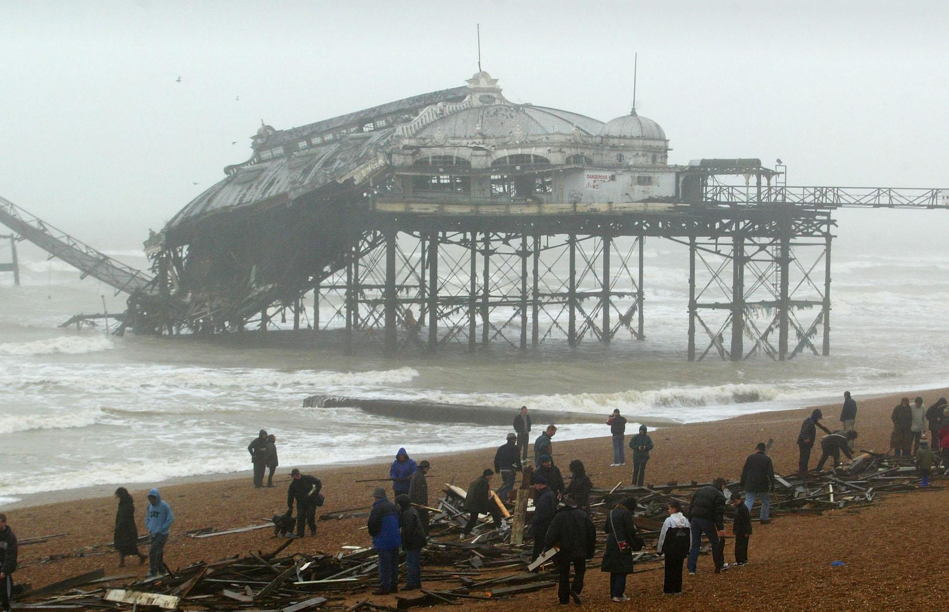 Slide 9 of 31: After decades of being pounded by the waves, the crumbling structure succumbed to heavy seas and strong winds in 2002, which caused a walkway to collapse and felled part of the concert hall. The remains of the once iconic pier caught fire the following year, in a suspected act of arson. Part of the derelict Grade I-listed structure's eastern side crumbled into the sea in January 2013 following winter storms. However the evocative ruins remain a striking landmark on the seafront. See more of the world's most historic piers and boardwalks here.