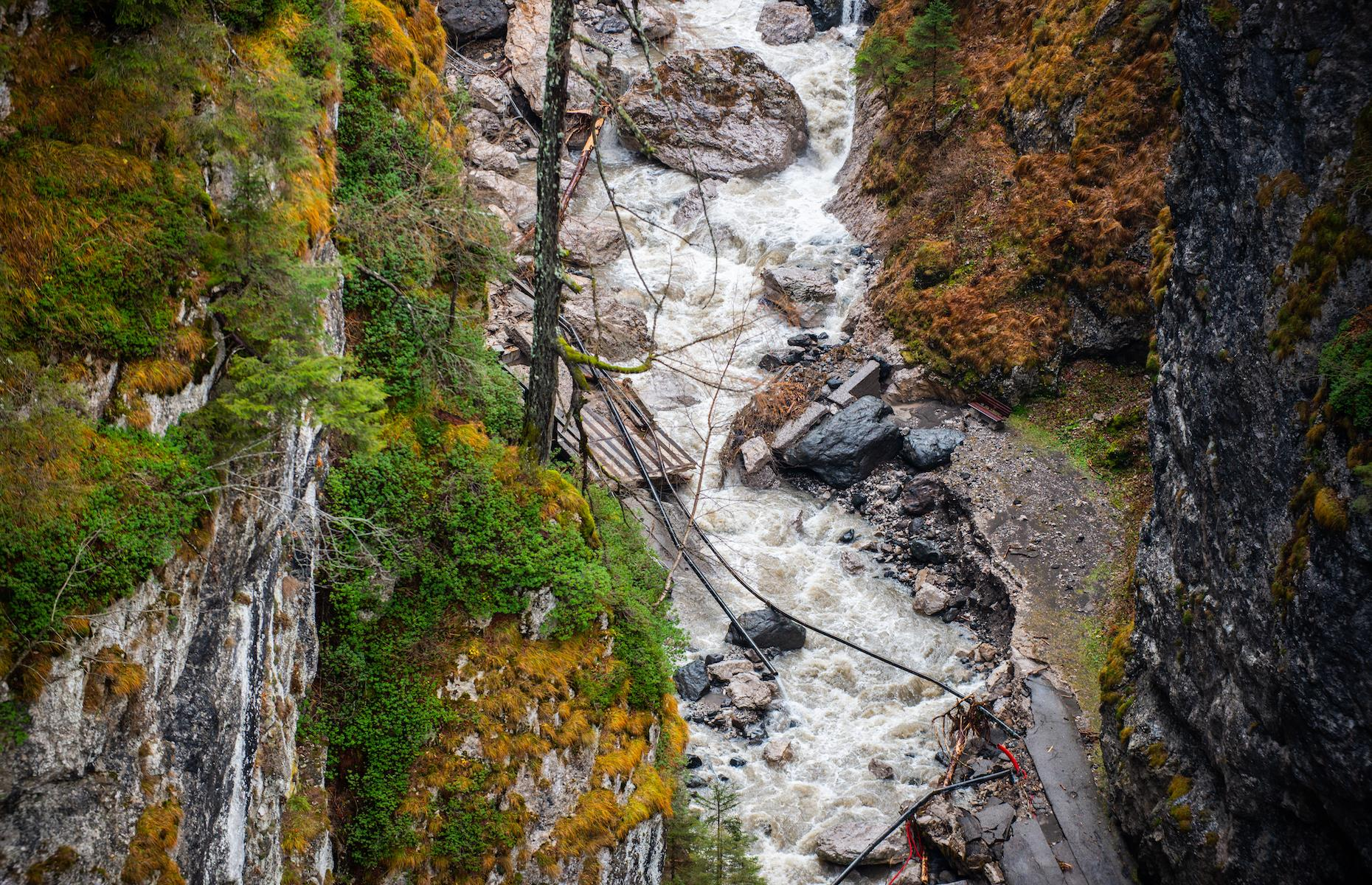 Slide 15 of 31: The heavy rains and gales, which buffeted the Dolomites as well as other parts of Italy for five days, also caused mudslides and flooding. The narrow and winding road that follows the Pettorina river through the Sottoguda gorge, a popular tourist attraction, was totally demolished by the flooding (pictured). It is thought that around 14 million pine trees and red spruces were also razed by the storms.