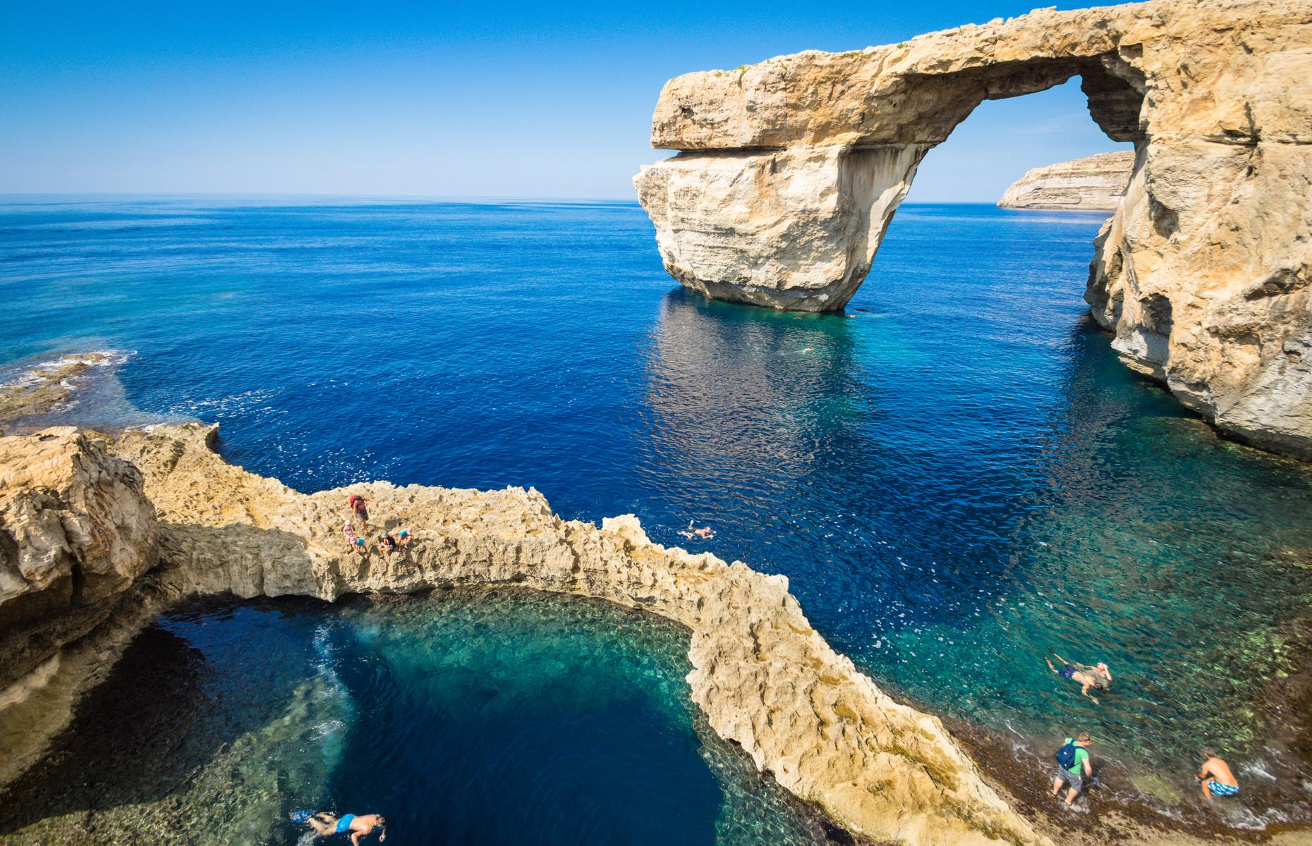 Slide 2 of 31: A limestone arch known as the Azure Window was one of Malta's top tourist spots and featured in numerous films and TV series such as Game of Thrones. The spectacular sea arch, near Dwejra Bay on the gorgeous island of Gozo, was shaped by centuries of natural coastal erosion.