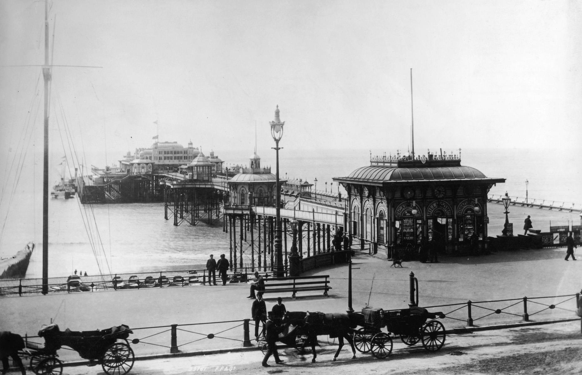 Slide 8 of 31: Brighton's West Pier opened to great fanfare in 1866 during the Victorian boom for beach vacations. An archetypal example of UK seaside architecture, the pier was added to over the years and at its prime featured a concert hall, funfair and tearoom. It was extremely popular in the late 19th and early 20th centuries and became a much-loved landmark on the Brighton seafront. The West Pier fell into financial decline in the 1960s, before closing in 1975 and falling into disrepair.