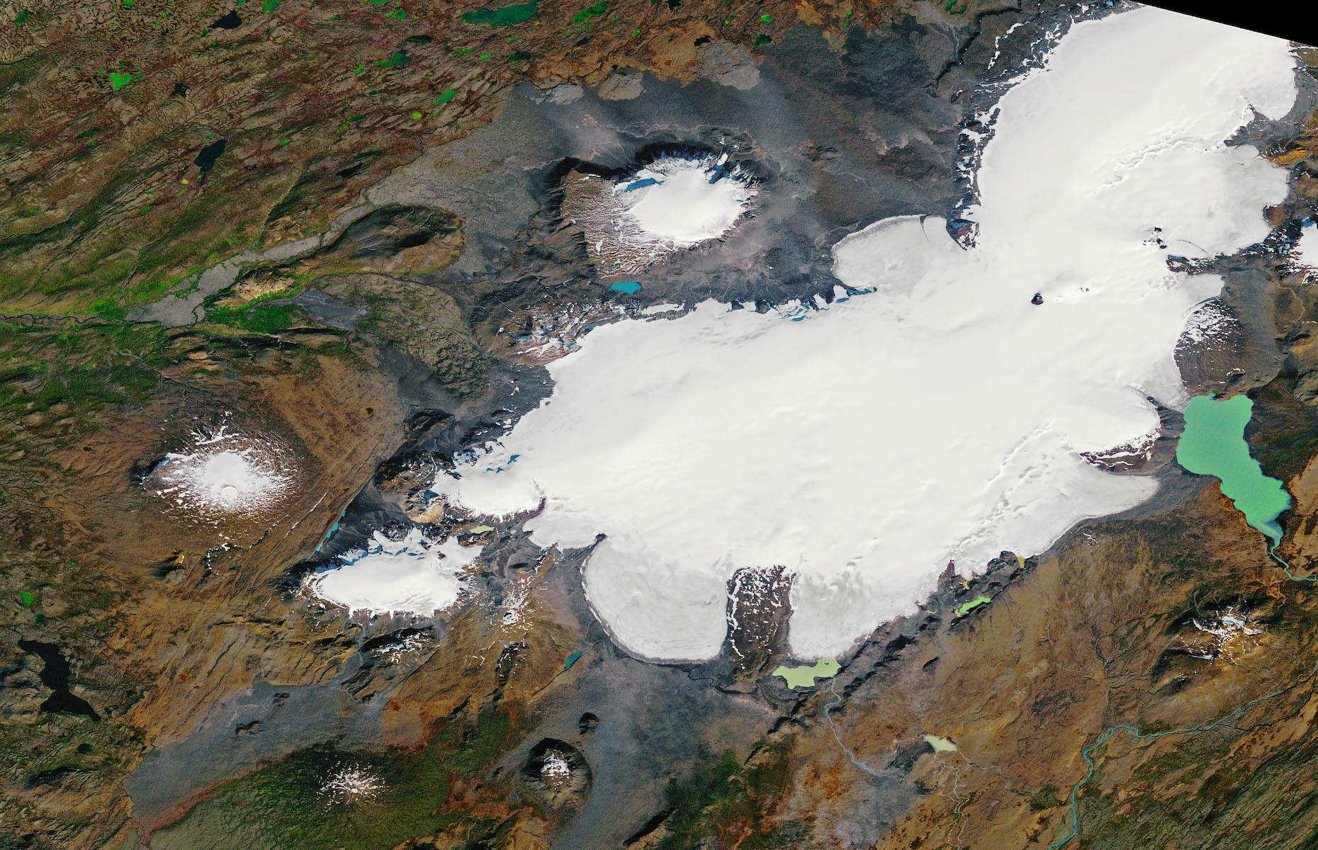 Slide 16 of 31: Renowned for its pristine and otherworldly icy landscapes, Iceland's topography is being dramatically affected by climate change. The Okjökull glacier (pictured by satellite here in 1986), on top of the Ok volcano in western Iceland, covered 6.2 square miles (16sq km) in 1890. By 2012, it measured just 0.2 square miles (0.7sq km), according to a report from the University of Iceland. The glacier was officially declared dead in 2014 – the first in the country to lose its status.