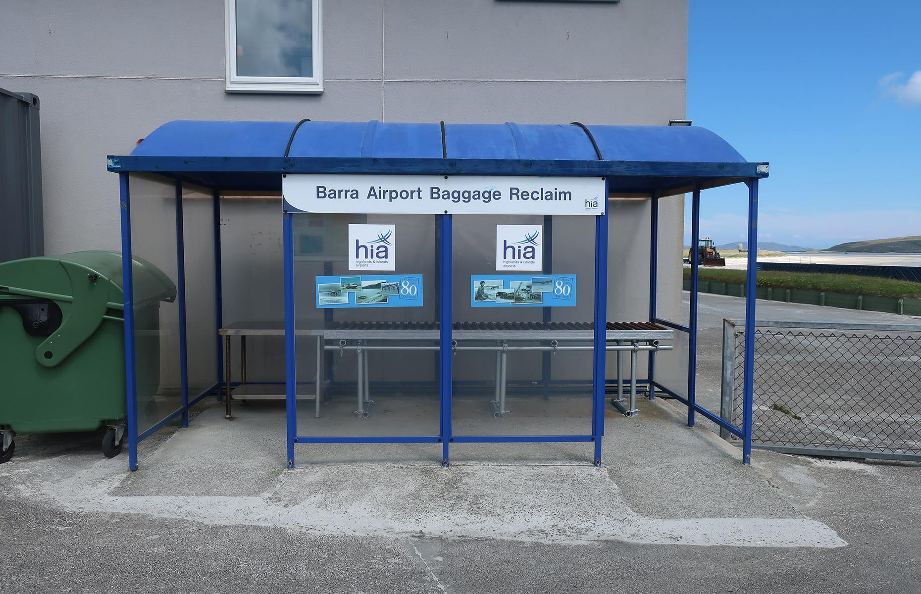 Slide 7 of 36: The beach is tidal, meaning the runways are underwater at certain times of day. Schedules are dictated by the tides, runways are marked by wooden poles at each end, and the baggage reclaim looks more like a bus stop than an arrivals hall. Its facilities are minimal, but when arriving onto the soft white sand of the Isle of Barra, none of that really matters – it's all about the scenery here.