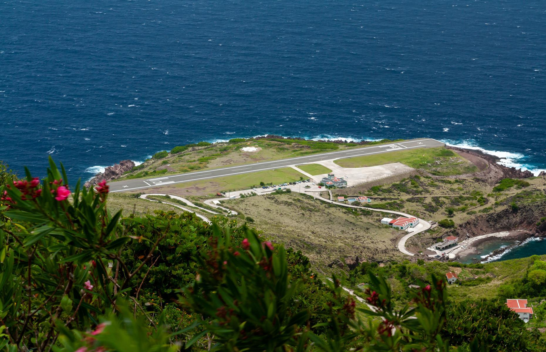 Slide 35 of 36: The borders on the tiny Caribbean island of Saba are currently still closed, but this airport is one to bookmark for a later date. Juancho E. Yrausquin is notorious for its scary runway – at only 1,312 feet (400m) long it's the world's shortest commercial runway. Not only that, but the airstrip is flanked by precipitous cliff drops at both ends.