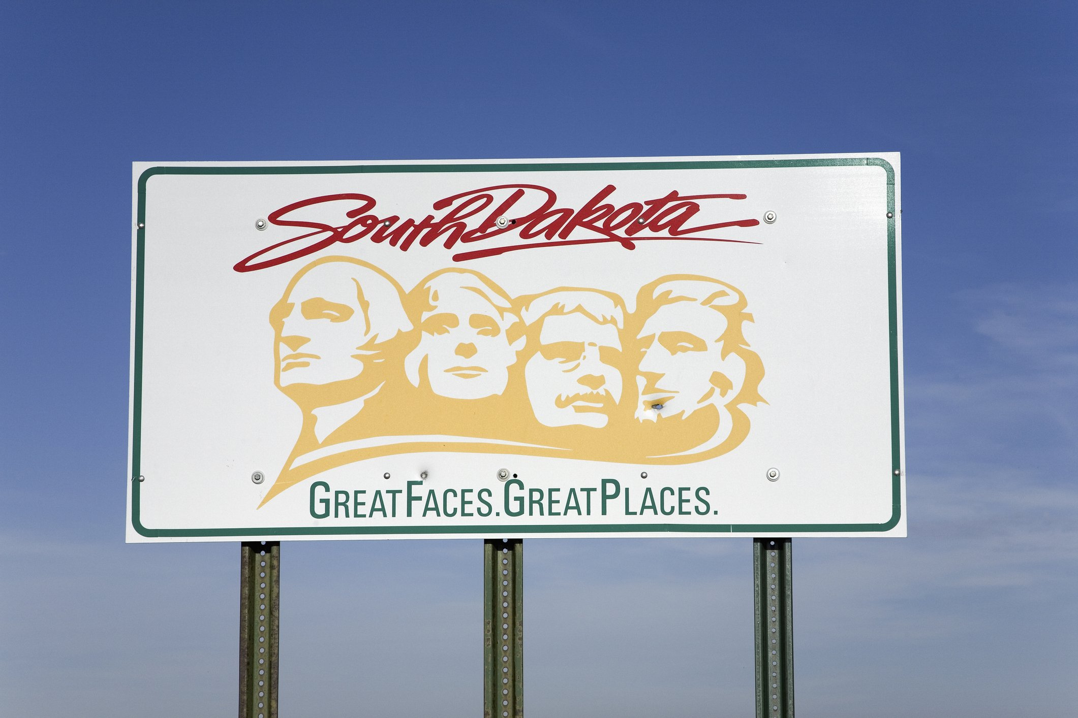 """Slide 42 of 51: South Dakota's sign pays tribute to the state's iconic landmark, Mount Rushmore, and has the second cheesiest motto of them all, """"Great Faces, Great Places."""" Check out this story of a father who actually helped carve Mount Rushmore."""