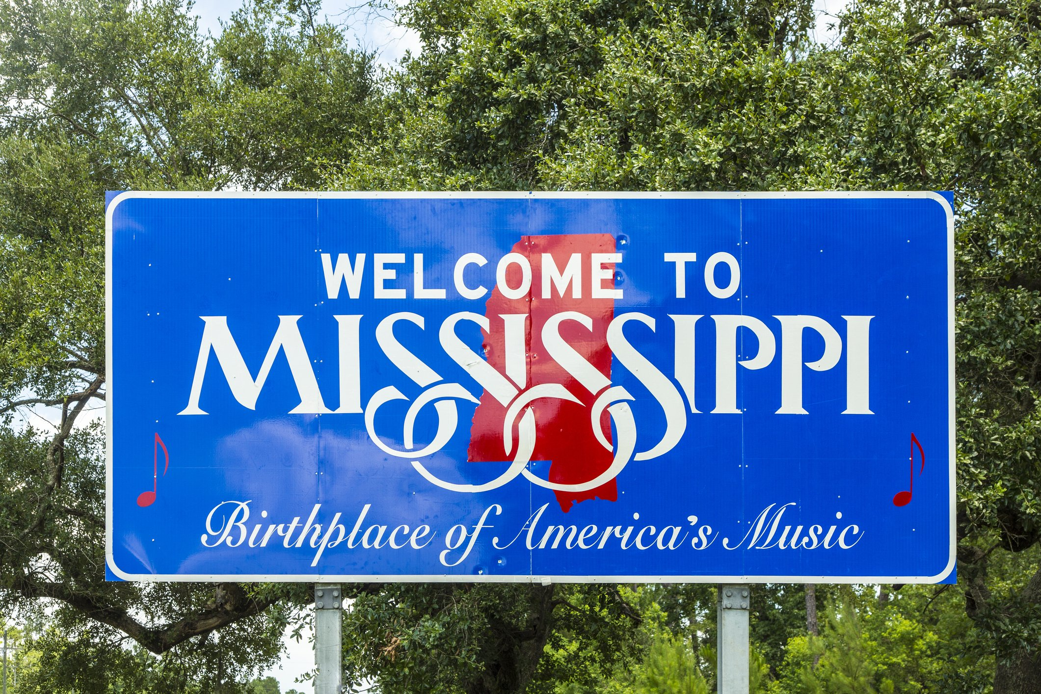 Slide 25 of 51: Mississippi's sign highlights its rock 'n' roll history with a sleek design.