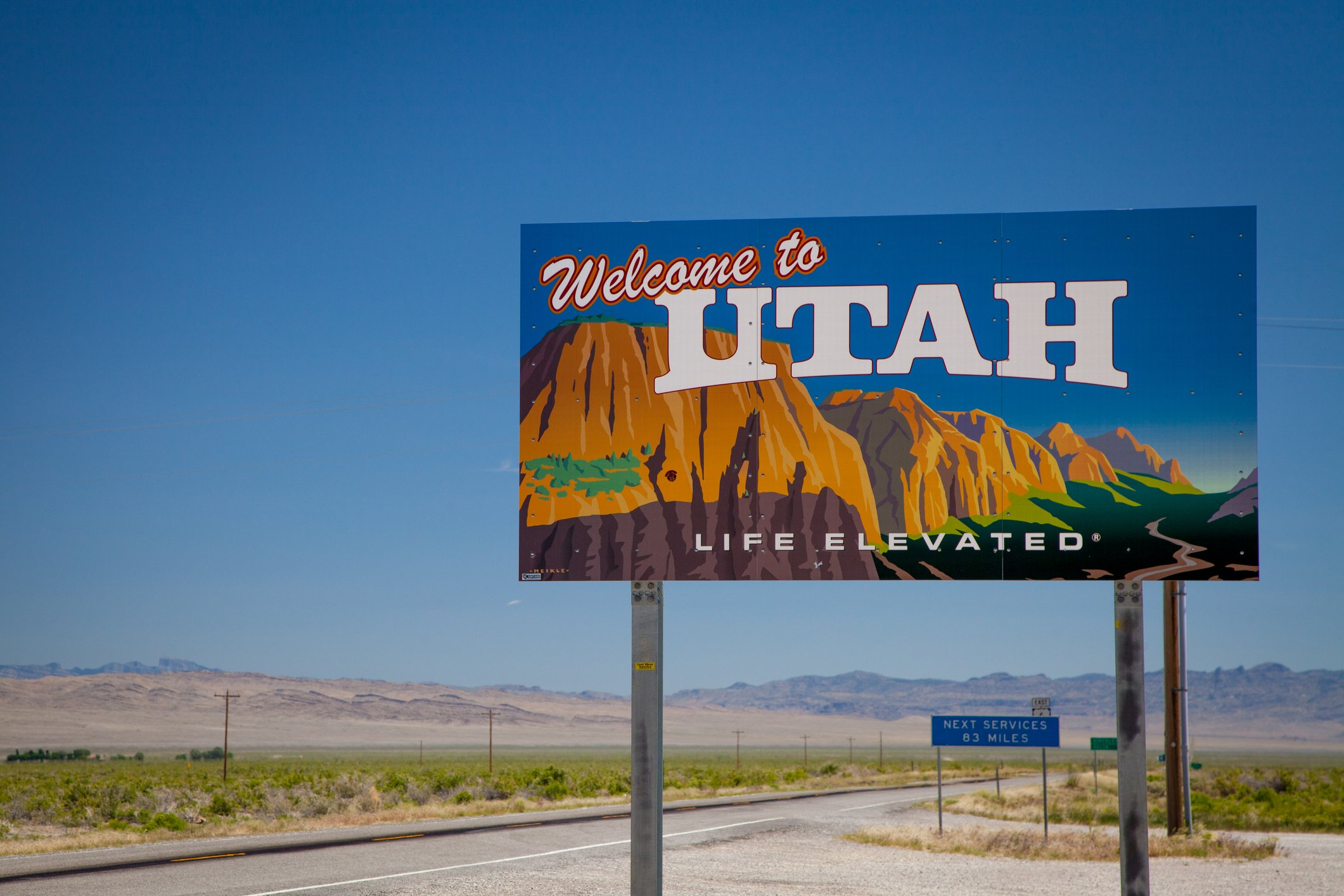 Slide 45 of 51: This is just one of the seven different welcome signs of Utah at different access points across the state. Don't miss the most underrated cities to visit in the United States. Hint: A cool city in Utah is found on the list.