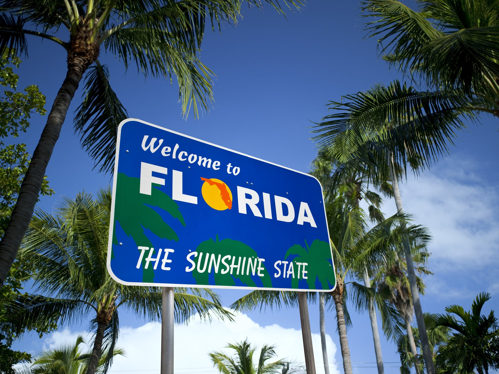 """Slide 10 of 51: The sign for Florida remarkably lacks Mickey Mouse, but the palm trees and orange do beautifully capture the essence of the state. Speaking of Mickey, here's what the """"new normal"""" of Disney parks look like."""