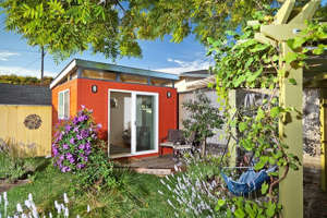 a garden in front of a house: Modern-Shed
