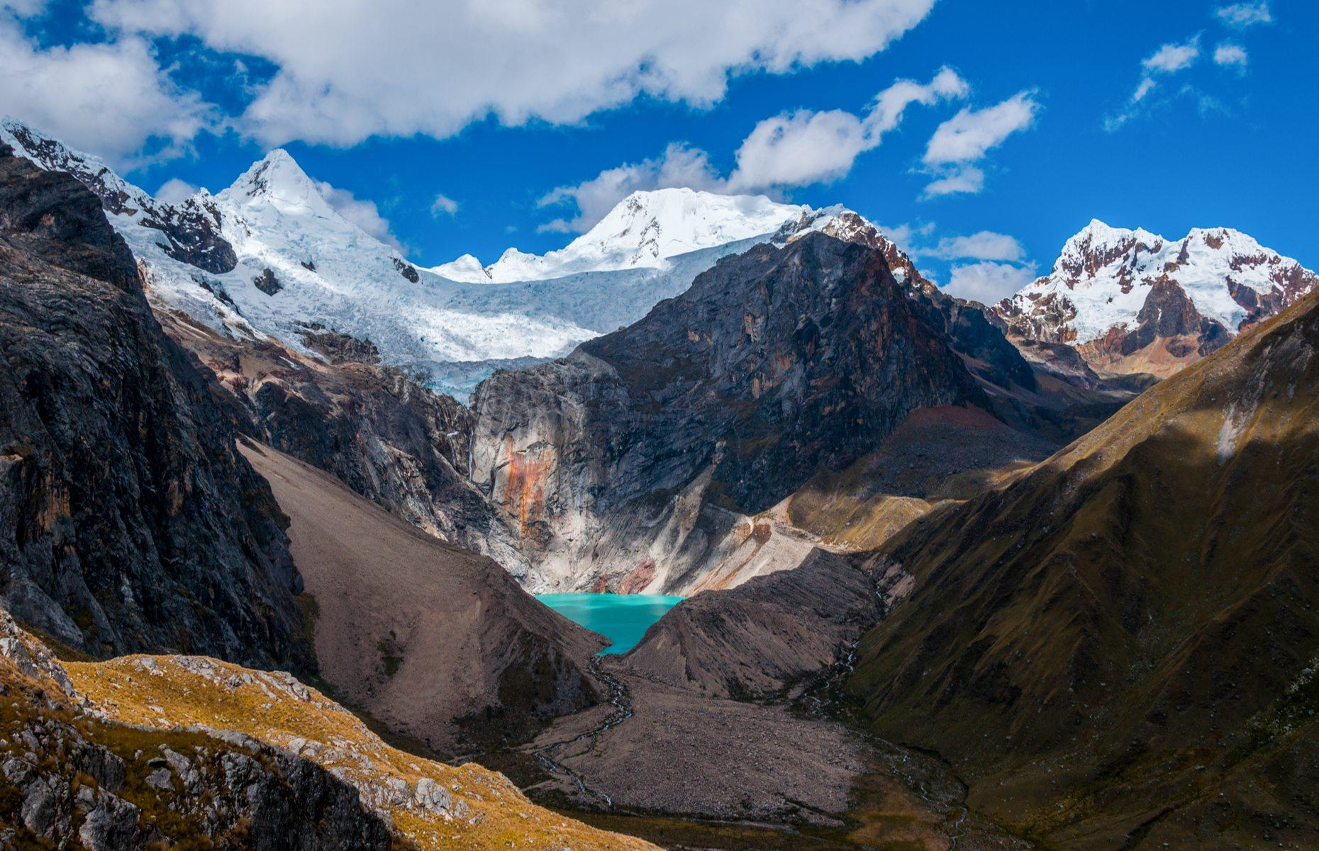 Slide 3 of 31: Set in the world's highest tropical mountain range, the Cordillera Blanca, Peru's Huascarán National Park is the next most Instagrammed scene, with just over 28,000 posts capturing its famous turquoise lakes and mountain scenery. Soaring a mighty 22,205 feet (6,768m), the park centers around its namesake mountain, Mount Huascarán, Peru's highest peak. The eye-popping blue lake Laguna 69, is another favorite amongst visitors, sitting at the foot of Pisco Mountain.