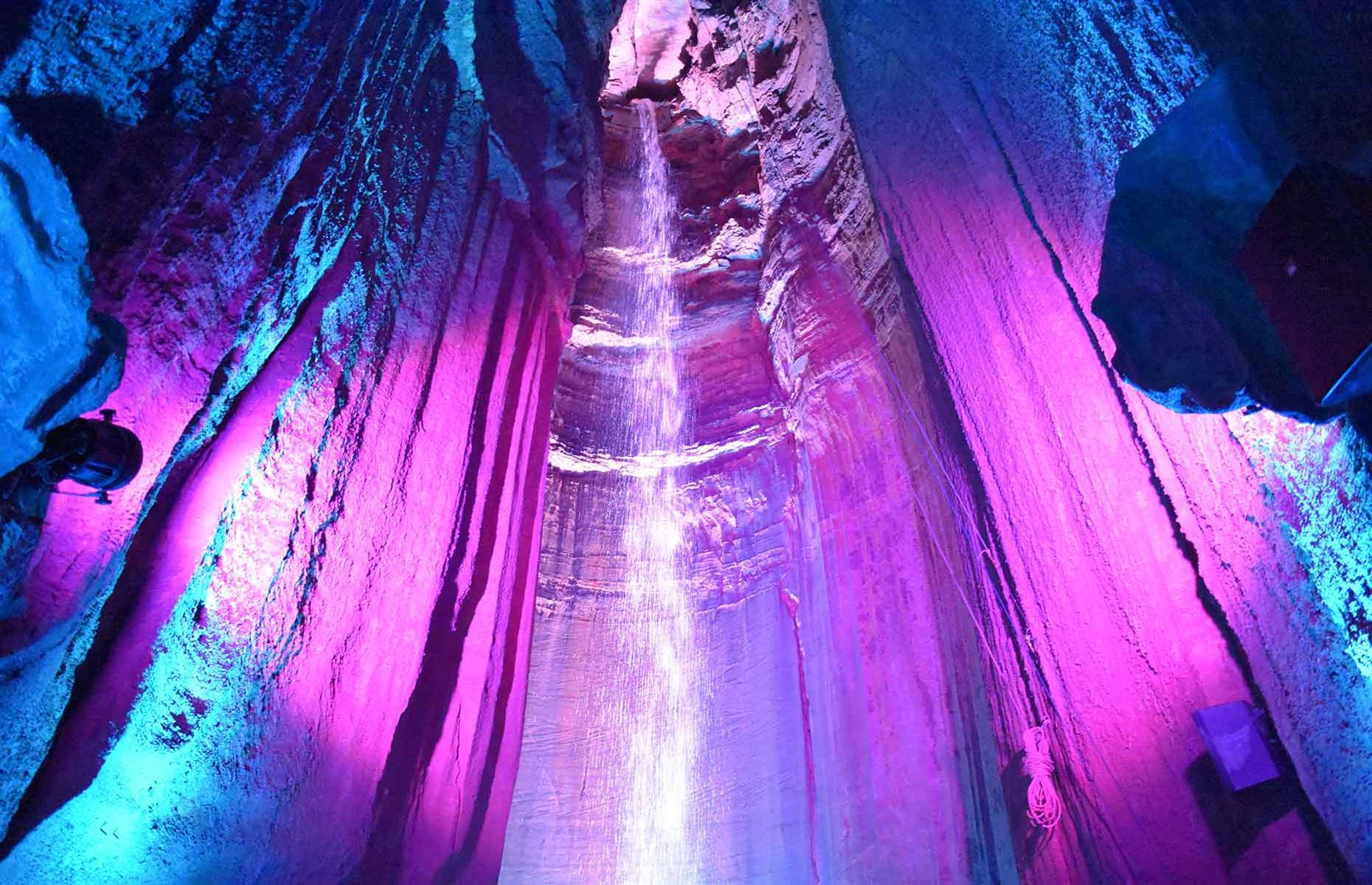 Slide 24 of 27: Ruby Falls is hidden 1,120 feet (341m) inside Tennessee's Lookout Mountain. This cascade of water tumbles 145 feet (44m) into a limestone cave, against the backdrop of music and illuminated by colorful lights. Guided tours take you on the underground walk to the falls and, if bright lights and music aren't your thing, there are limited spots available on evening tours, where the walk and falls are lit by lanterns.