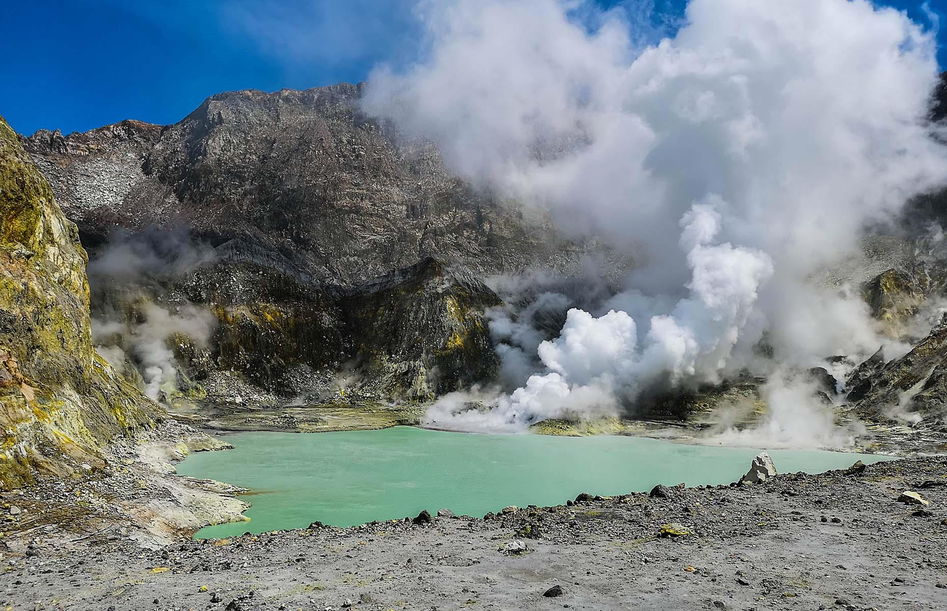 Slide 9 of 41: The otherworldly landscape is tinged yellow from the sulfur – the smell can be overwhelming and all visitors to White Island are issued with a gas mask and a hard hat. It last erupted in 2019 with tourists out on the crater and in boats in the water nearby. Sadly, 20 people perished in the eruption and tours have been suspended ever since.