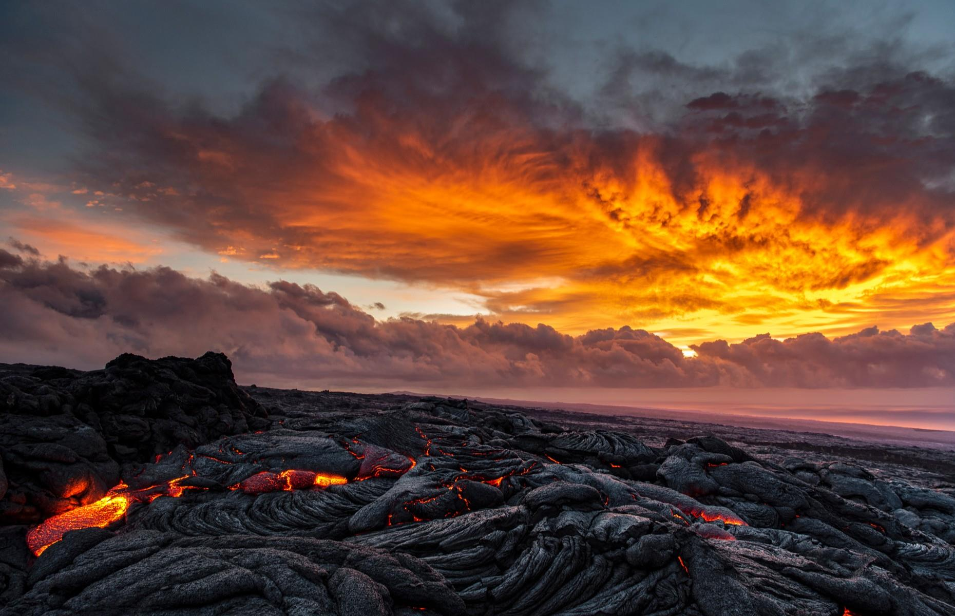 Slide 2 of 31: Making it into the top 30 with just over 25,000 posts, tucked away from Hawaii's pristine sandy beaches, the Hawai'i Volcanoes National Parkis like another planet. Established in 1916 on the Big Island, the park is home to Kīlauea, one of the most active volcanoes in the world. Kīlauea's lava continuously flows across the rocky wasteland, with steam rising from the cracked earth resembling a scene from space.