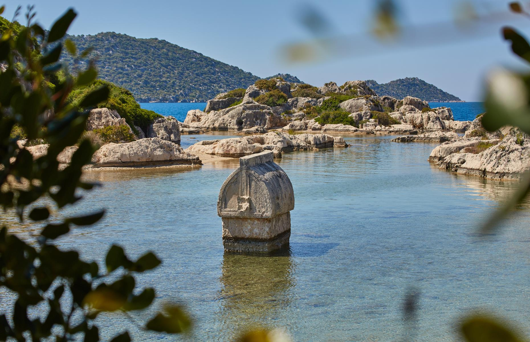 Slide 25 of 25: The island of Kekova remains uninhabited, aside from a scattering of grazing goats, and is designated a Specially Protected Area as well as being on UNESCO's tentative list as a World Heritage Site. Diving and snorkeling are banned to protect the ruins, though some tour boats are allowed to pass by slowly. Many of Simena's incredible structures, including ornate tombs that rise above the water level, can be seen from dry land.