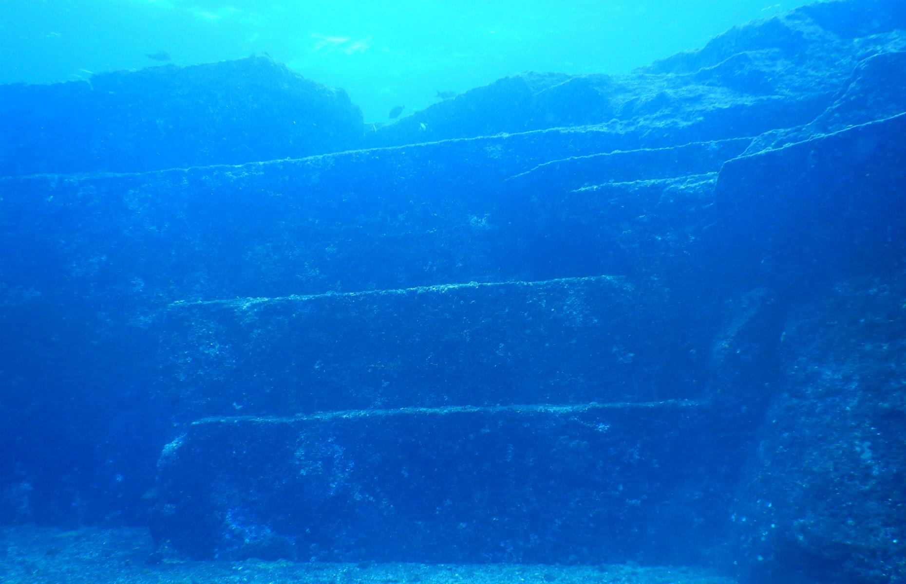 Slide 13 of 25: Between the East China Sea and the Pacific Ocean lies an enigma wrapped in mystery. A series of stone formations, from vertiginous monoliths to stacks of slabs and a pyramid, were spotted close to the remote Japanese island of Yonaguni in the mid-1980s by a local diver. Historians and scientists have been puzzling over their origins ever since – and often arguing about it.