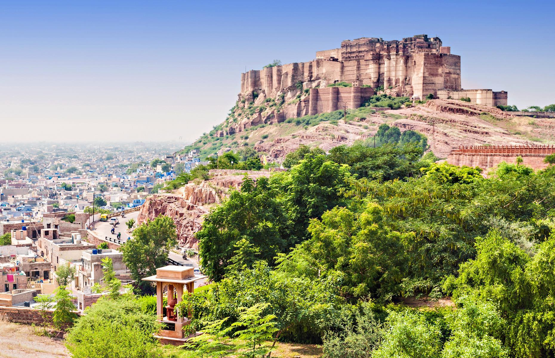 Slide 10 of 61: Mehrangarh Fort has guarded the northwestern city of Jodhpur since 1459. Built by Rao Jodha, the Rajasthani ruler who founded Jodhpur, the fort is built atop a rugged hill that soars some 400 feet (122m) above the land below.