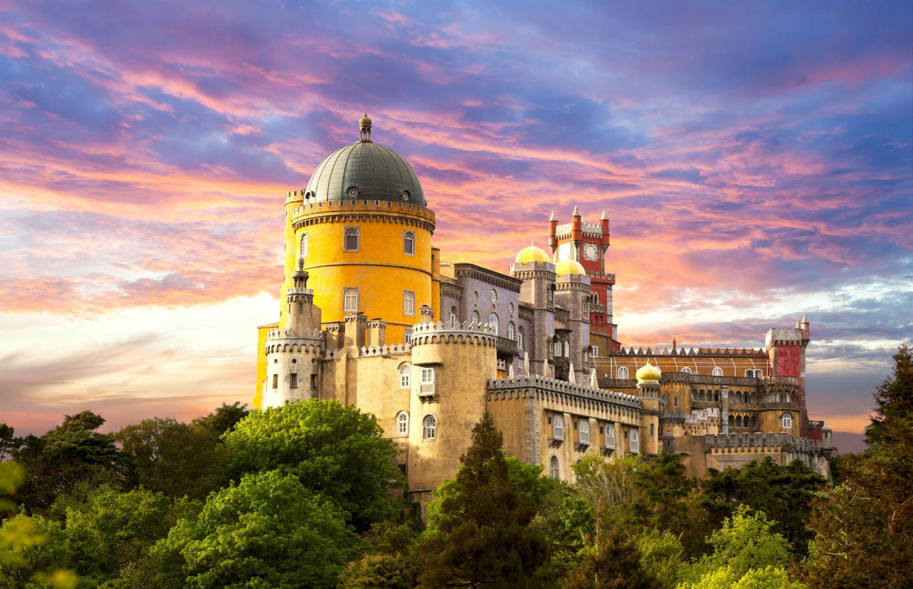 Slide 38 of 61: The enchanting Pena Palace, near Sintra, has a storybook quality about it. Designed in a 19th-century Romantic style, it started life as a chapel. King Ferdinand II of Portugal elevated it to its current magnificence after acquiring the property in the 1830s.