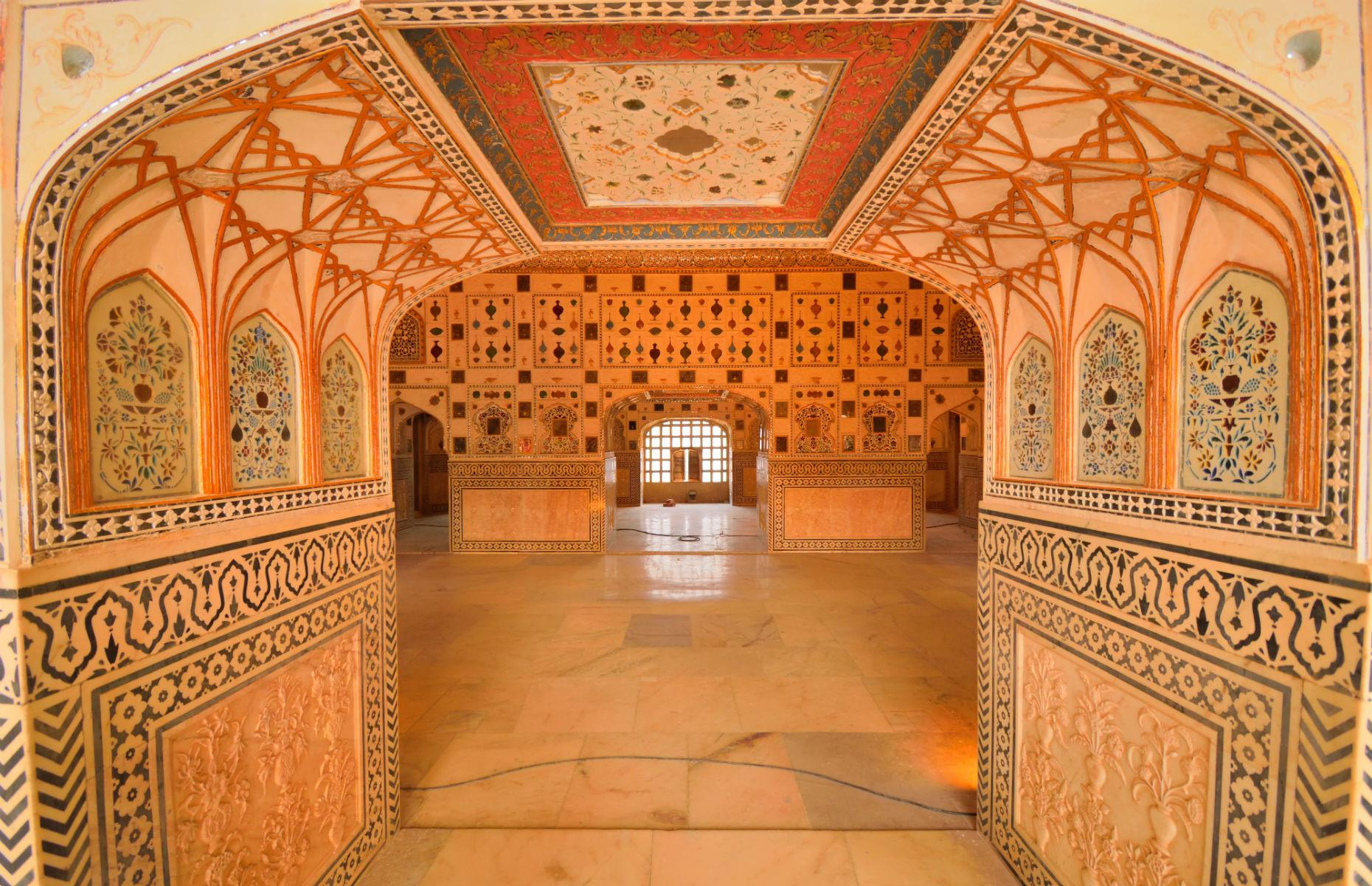 Slide 27 of 61: The imposing castle that stands today was started in the 16th century and has been the home of many Rajasthani royals over the years. Inside, the exquisite Sheesh Mahal, or mirror palace (pictured), is one of the highlights and has been immaculately preserved.