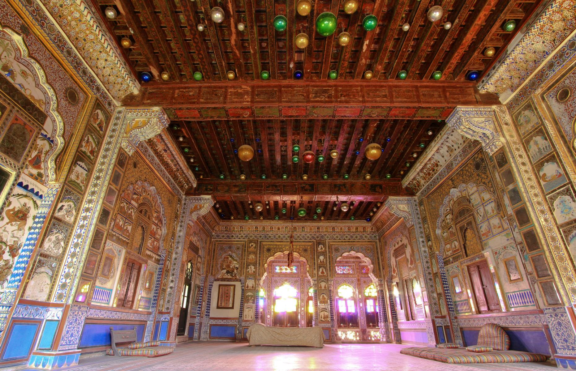 Slide 11 of 61: The fort was embellished and expanded over about five centuries and the result is a sumptuous hodgepodge of architectural styles. Palace rooms burst with colored glass, mirrors and mosaics too – one of the most beautiful is the opulent Phool Maha or Flower Palace Room.
