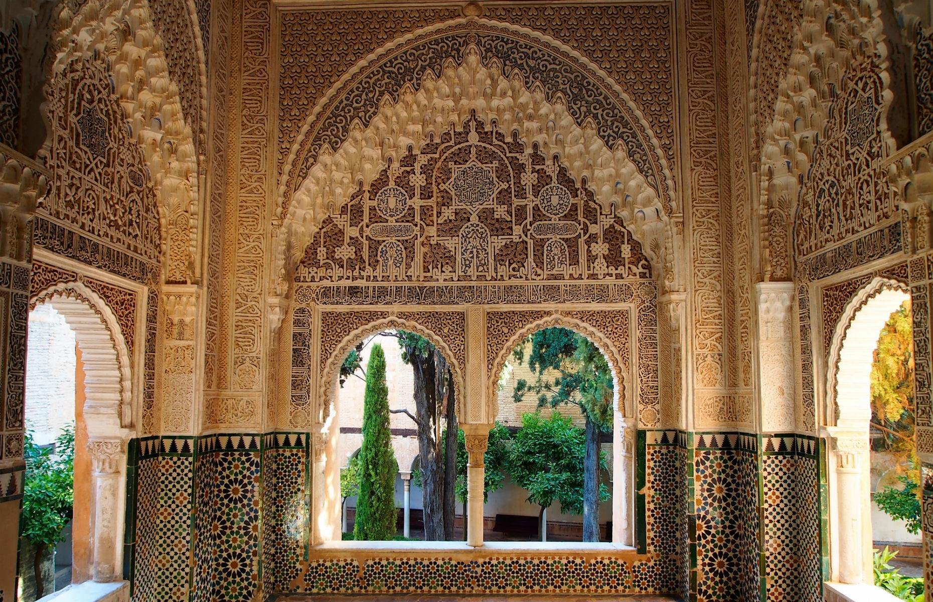 Slide 33 of 61: The Alhambra's buildings are elaborately decorated from floor-to-ceiling, and it's easy to imagine Moorish monarchs wandering through the airy corridors and stunning grounds. Its beauty has inspired many works of literature and film, too, including Washington Irving's Tales of the Alhambra.