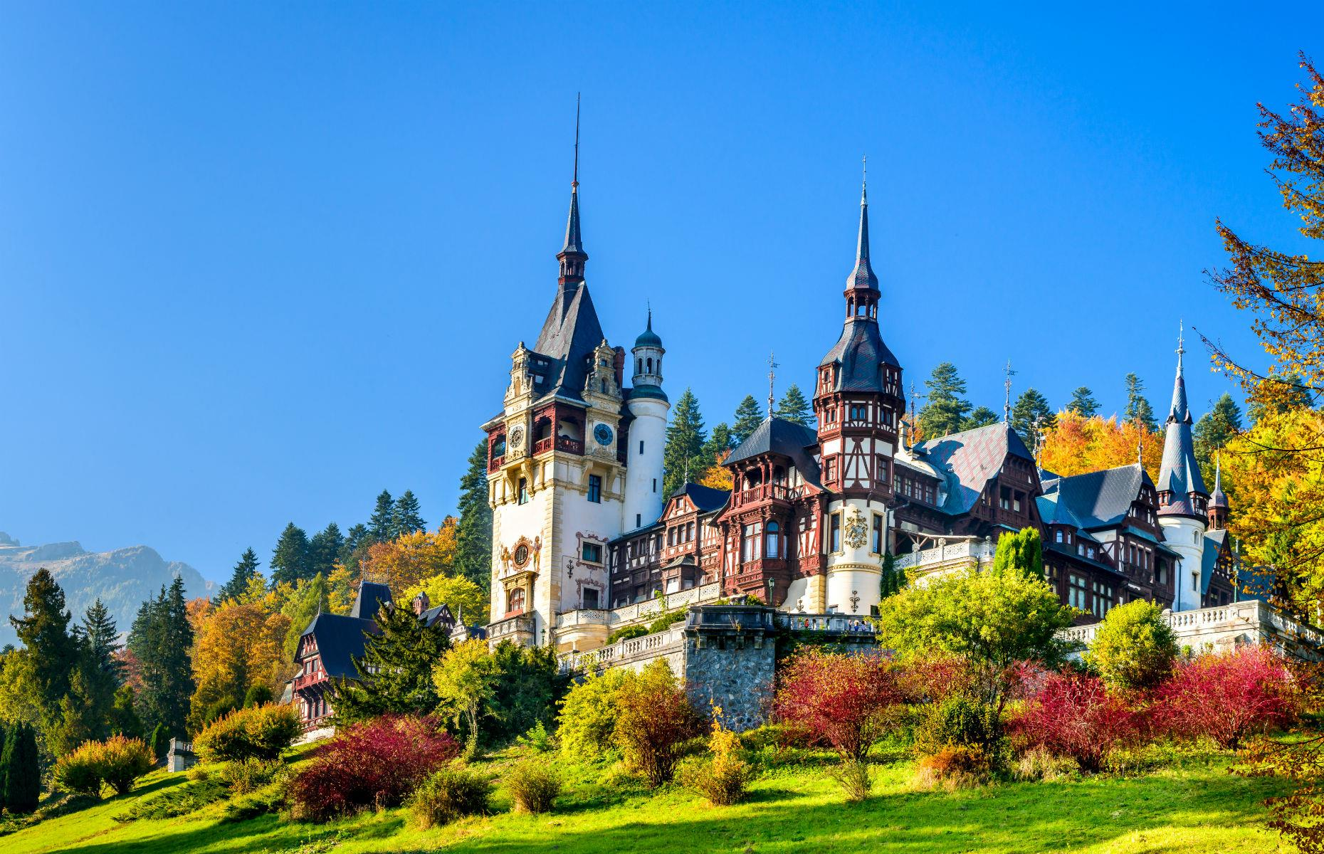 Slide 42 of 61: The picturesque Peleș Castle was constructed in the 19th century for Romanian King Carol I, who fell in love with the Carpathian Mountains and decided to build a summer retreat here. It's not a modest affair, either: the pile in Sinaia, central Romania is a striking mix of Neo-Renaissance and Gothic Revival architecture.