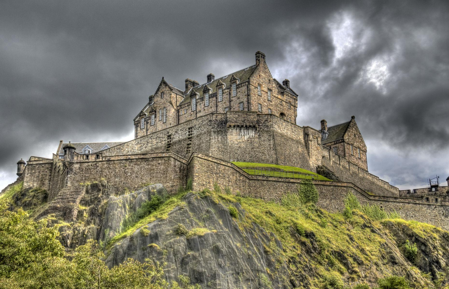 "Slide 28 of 61: Edinburgh Castle's imposing battlements overlook the city's Old Town. The castle dates back to the 12th century and has been attacked so many times that it has earned the dubious accolade of being ""the most besieged place in Great Britain""."