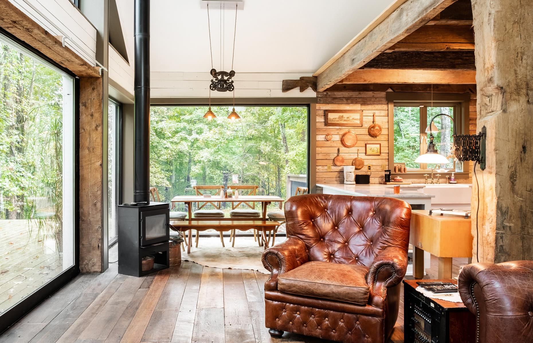 Slide 44 of 52: Made from recycled materials, this cozy cabin near Nashville is the ultimate secluded getaway. Hugged by the surrounding forest, the open-plan home has an attractive vintage feel to it. Thanks to the floor-to-ceiling picture windows, you can drink in the area's natural beauty from the comfort of an armchair. Check out America's most remote Airbnbs here.