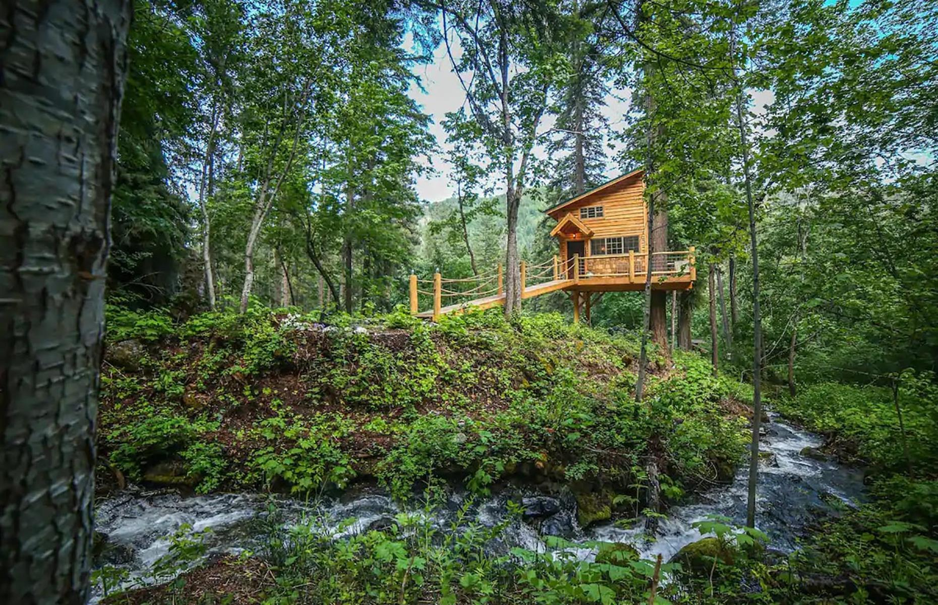Slide 49 of 52: Yes, there are plenty of stunning penthouses in Seattle with ocean and mountain views, but this treehouse escape looks like something out of a fairy tale. Surrounded by lush green forest and located right above the Hansel Creek, the one-bedroom timber house has a king-sized bed in the loft, a kitchen with all the essentials and a fire pit to toast marshmallows in the evening. There are opportunities to hike, bike, fish or even go white-water rafting in the surrounding area.