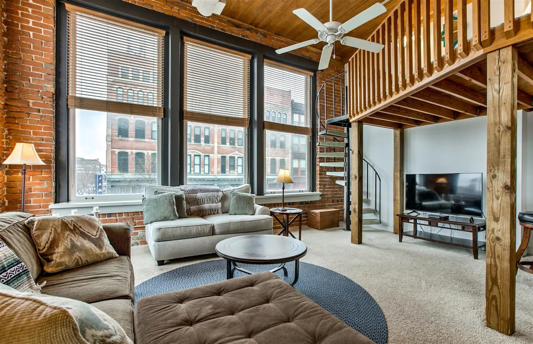 Slide 29 of 52: Centrally located in Omaha's famous Old Market district, this bright and cozy loft has two bedrooms, exposed red brick walls and everything you might need to enjoy a wonderful break. If you prefer staying in and making the most of your time in the loft, there are board games, a fully equipped kitchen for whipping up delicious meals and a large, cozy sofa to sink into and watch a movie.