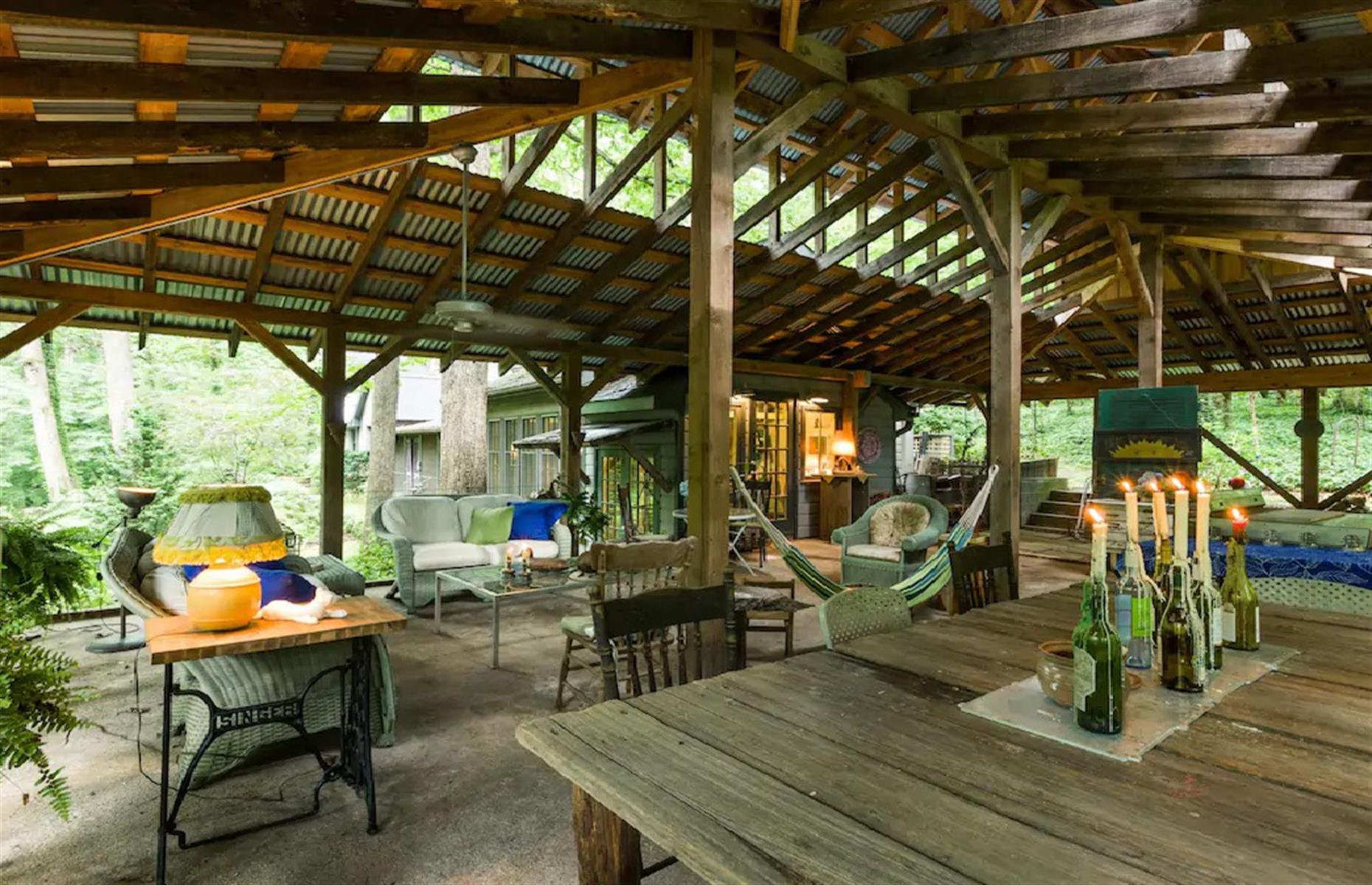 Slide 35 of 52: A one-of-a-kind home, this cabin in the woods is the peaceful and serene escape you've been looking for. Simplistic from the outside, high-tech on the inside, the three-bedroom cabin has an expansive outdoor living area, surrounded by lush woodland. Located just outside of Winston-Salem in North Carolina, it's a brilliant escape with all the necessities within easy reach.