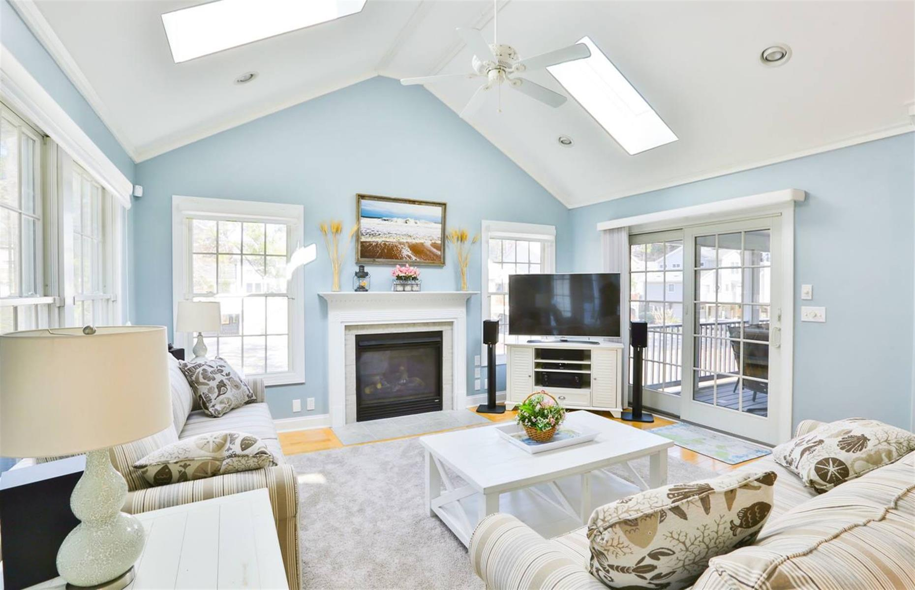 Slide 9 of 52: The definition of a coastal charmer, this Delaware home offers a cozy retreat in the heart of Bethany Beach. Just a 15-minute walk from the ocean, the house has everything you need for a peaceful break by the beach. There are four bedrooms, a beautiful kitchen and four decks, including a screened entertaining area.