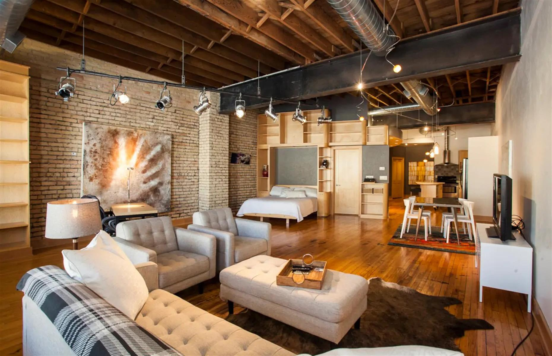 Slide 36 of 52: Offering the best of downtown living, this cool studio loft is located right at the heart of Fargo in North Dakota. The exposed brick walls are covered in paintings from local artists (that are available to buy), and the studio features a comfortable king bed just waiting for you to sink into. While you're not out exploring the city, there's a large sofa for downtime as well as a huge kitchen and a dining table.