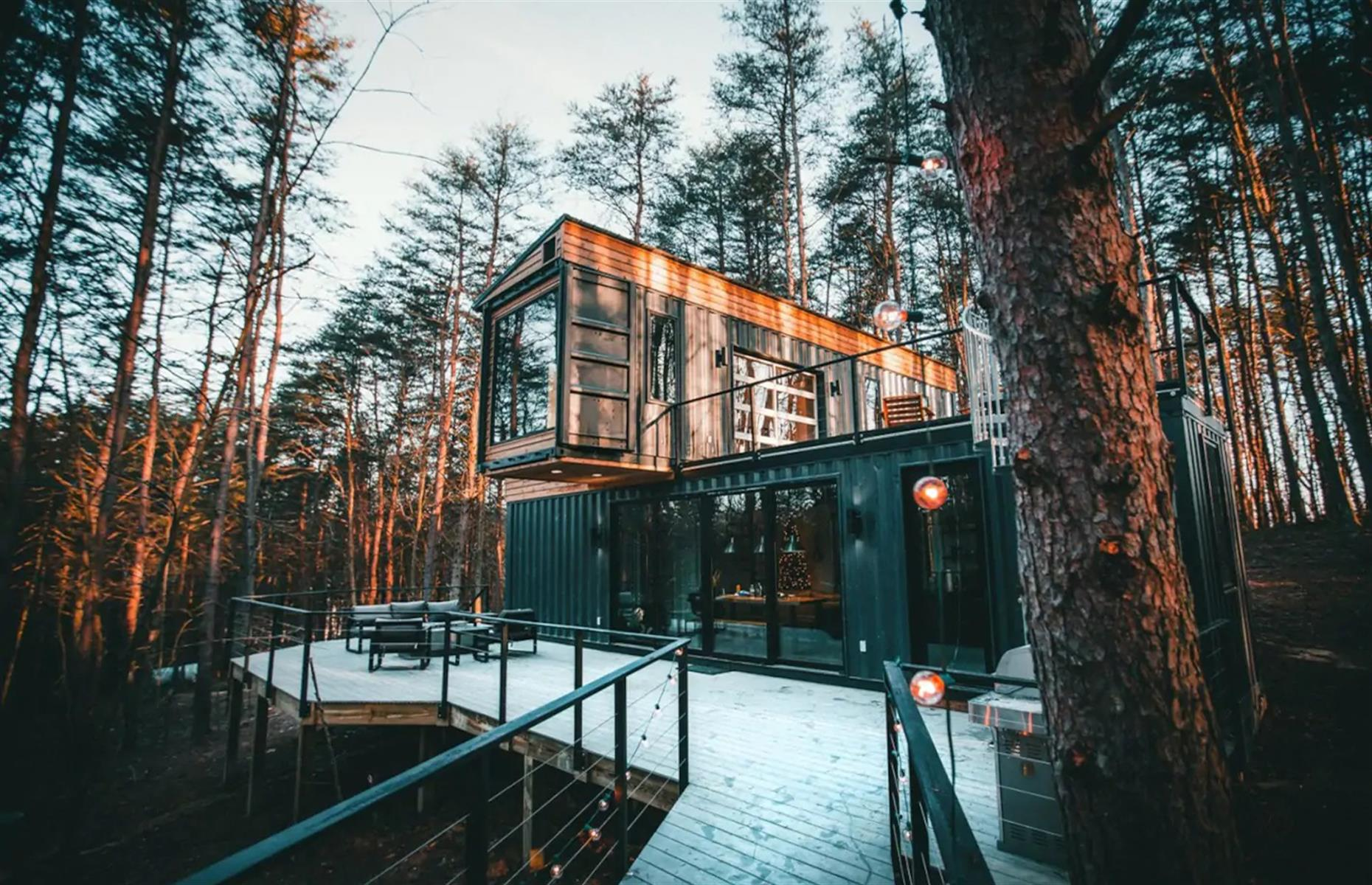 Slide 37 of 52: Three intermodal shipping containers have been transformed into an outstanding three-bedroom house hidden away among the trees in Rockbridge, Ohio. After a day of hiking, fishing or canoeing, snuggle up next to the cozy gas fireplace or take a dip in the hot tub nestled in the forest.