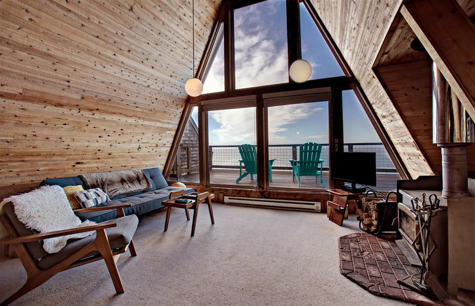 Slide 39 of 52: Go to bed with waves lulling you to sleep at this dreamy Oceanside escape. Located just steps from the beach, the two-bedroom home is an unusual A-shape, offering ocean panoramas and unobstructed views from Cape Meares to Cape Lookout. The cabin also has a large private deck with a wood-burning stove for chilly nights. The area offers plenty of opportunities for hiking and nature exploration, and you shouldn't pass a chance to try your hand at crabbing and clam digging.
