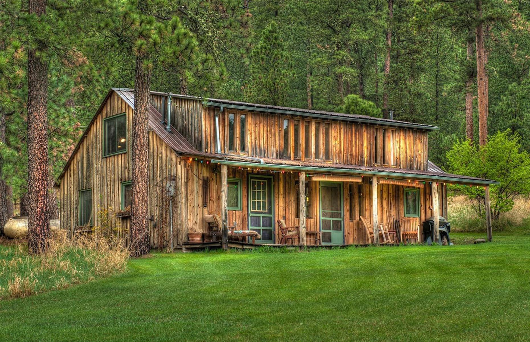 Slide 43 of 52: Enjoy true mountain living in total comfort at this Deadwood cabin located near Nemo, a tiny mountain town set in the picturesque valley of Boxelder Creek. Convenient for visiting South Dakota's most famous attractions, including Mount Rushmore, the brilliantly redesigned 1910s cabin has two bedrooms, a lofted cathedral ceiling and a large fireplace. See more of the world's most jaw-dropping ceilings here.