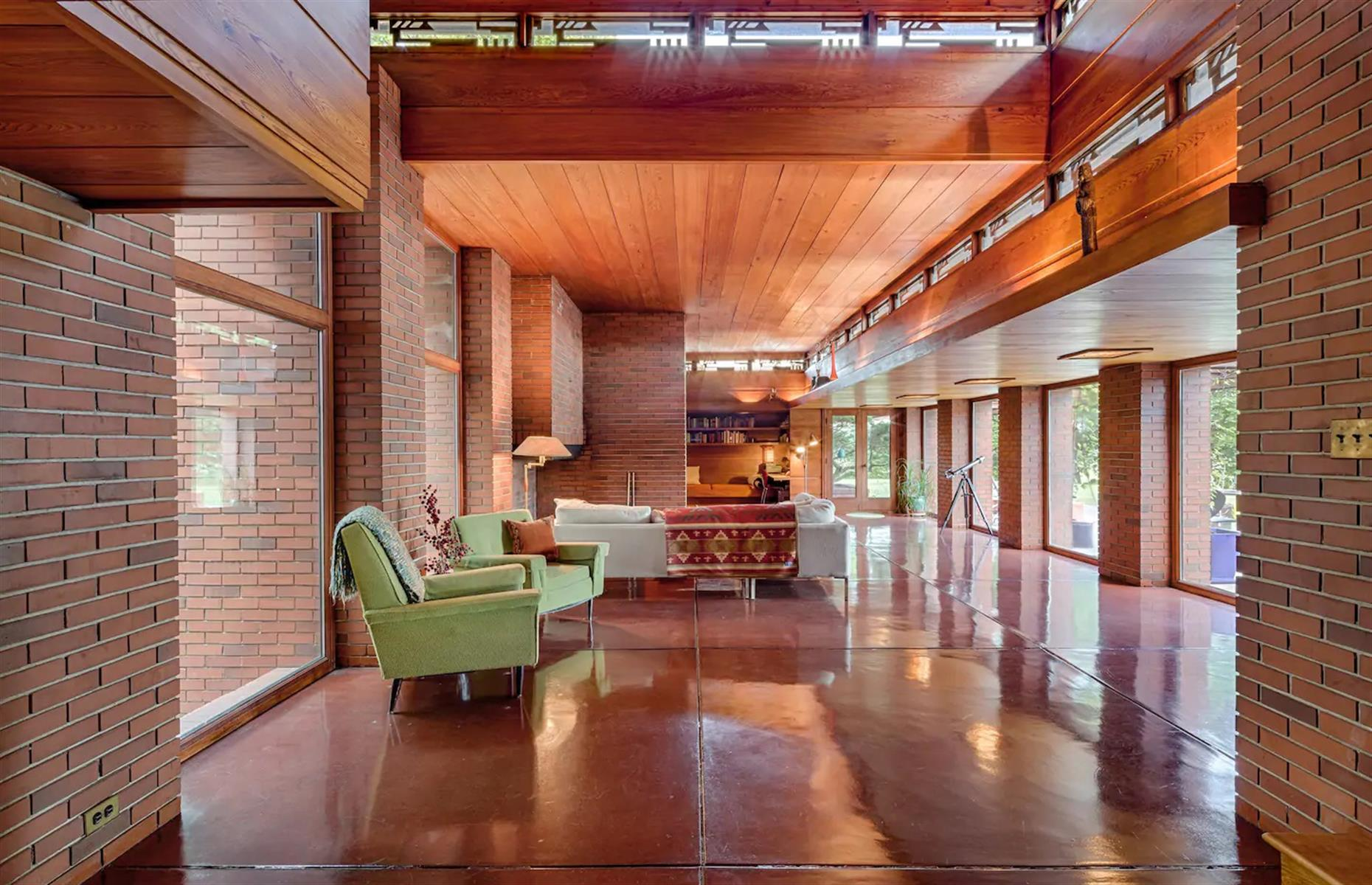 Slide 51 of 52: Built by the legendary American architect Frank Lloyd Wright, this home, located in Two Rivers, is an architectural and design masterpiece. Finished in 1940, the house retains lots of its original features that are complemented by modern amenities for a comfortable stay. The four-bedroom house features a large fireplace, floor-to-ceiling windows and thoughtful details throughout.