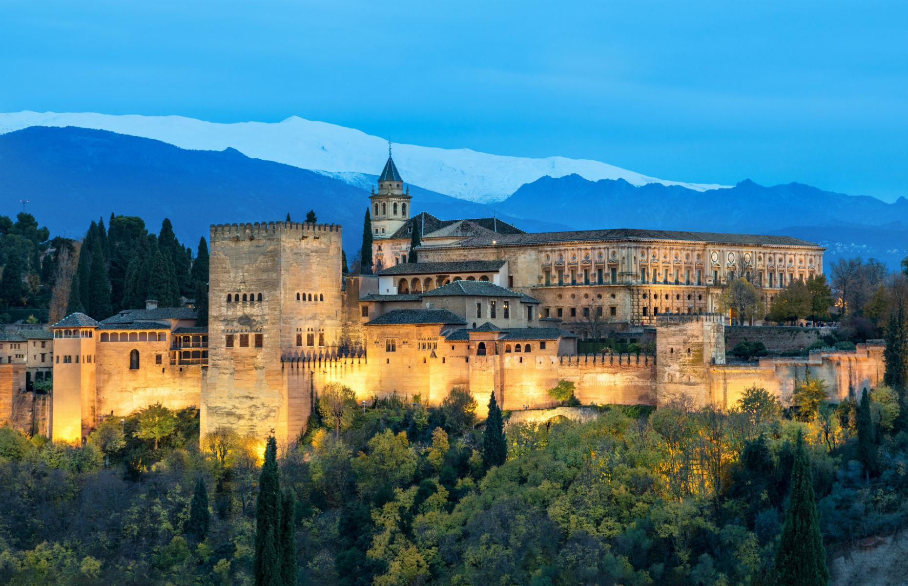 Slide 32 of 61: Granada's impressive Alhambra was built during Spain's Moorish period from the mid-13th century. The fortress, perched on a plateau above the city, served as a royal palace, and its exquisite gardens are laced with beautiful walkways and fountains.