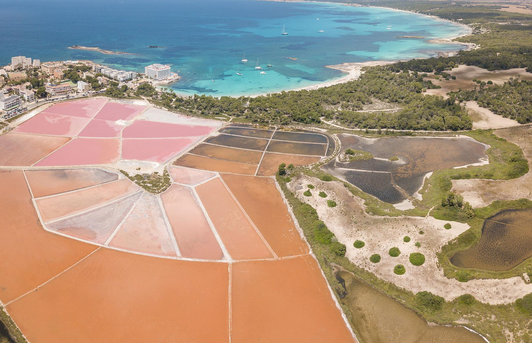 Slide 19 of 41: While it may look like a giant paint palette, this pink landscape is actually made up of salt flats and is situated in the seaside resort of Colonia de Sant Jordi in Mallorca's Ses Salines district. Salt is a major export here and a great source of local pride – a symbol of a salt mound even appears on the area's coat of arms. The colors – earthy pink, deep tan and rich nude – pop when captured from up high.